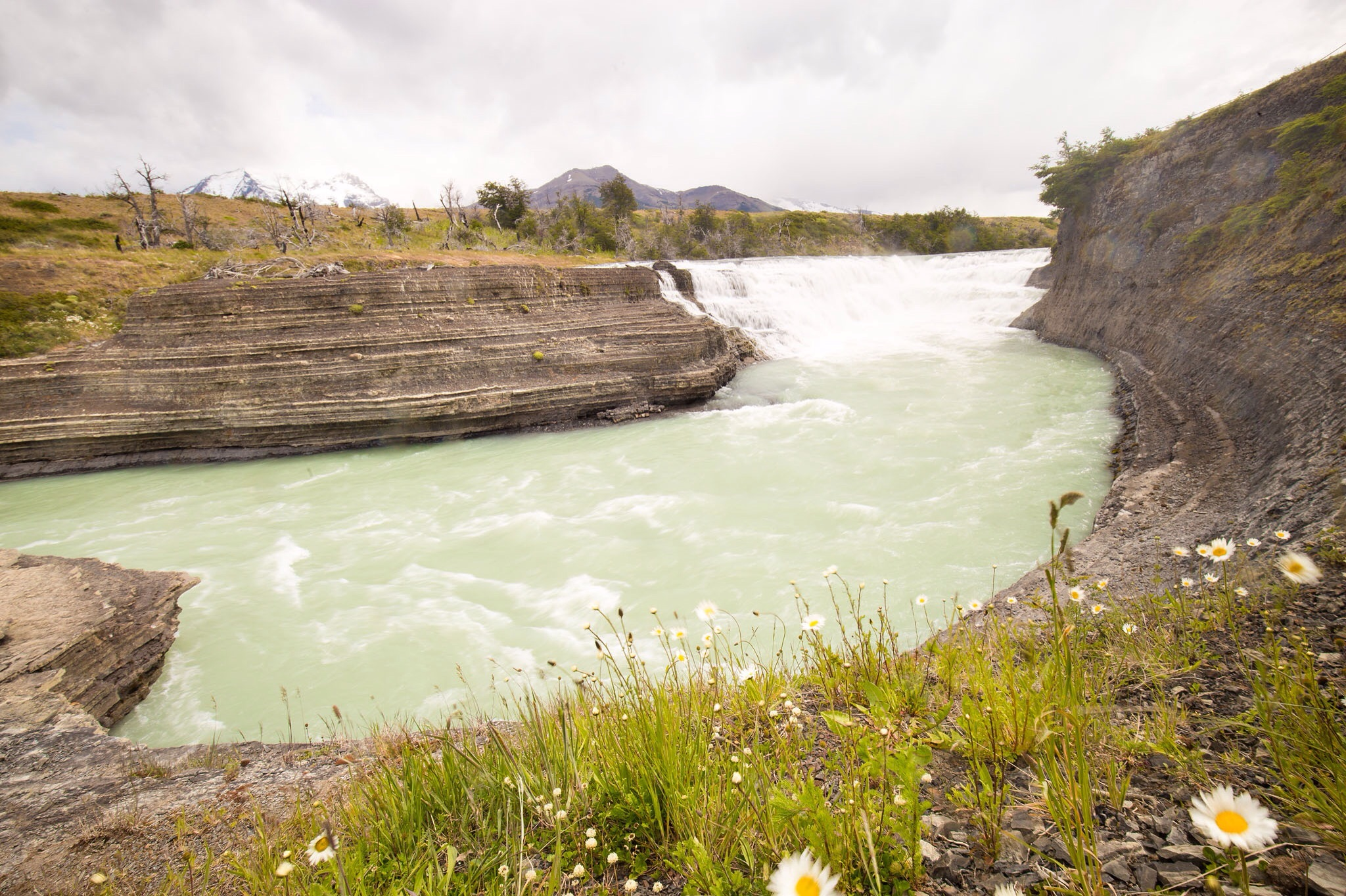 Wedding-Travellers-Overlanding-Destination-Wedding-Chile-Torres-del-Paine-waterfall-river-cliff