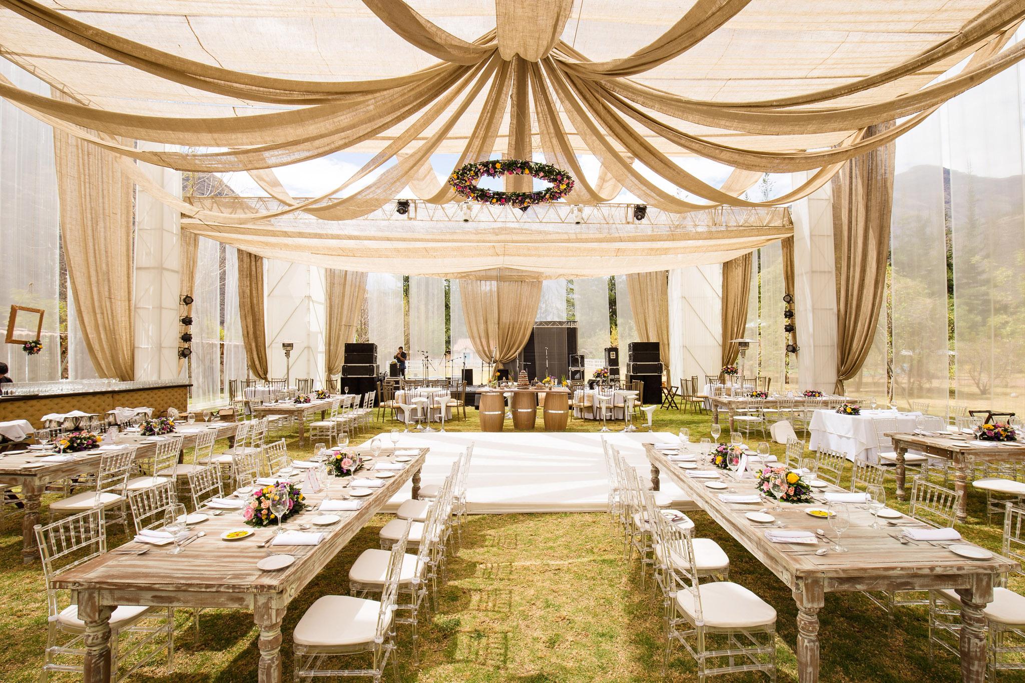 Wedding-Travellers-Destination-Wedding-Peru-Cusco-Hacienda-Sarapampa-Sacred-Valley-tent-outside-wood-natural-linen-light-brown