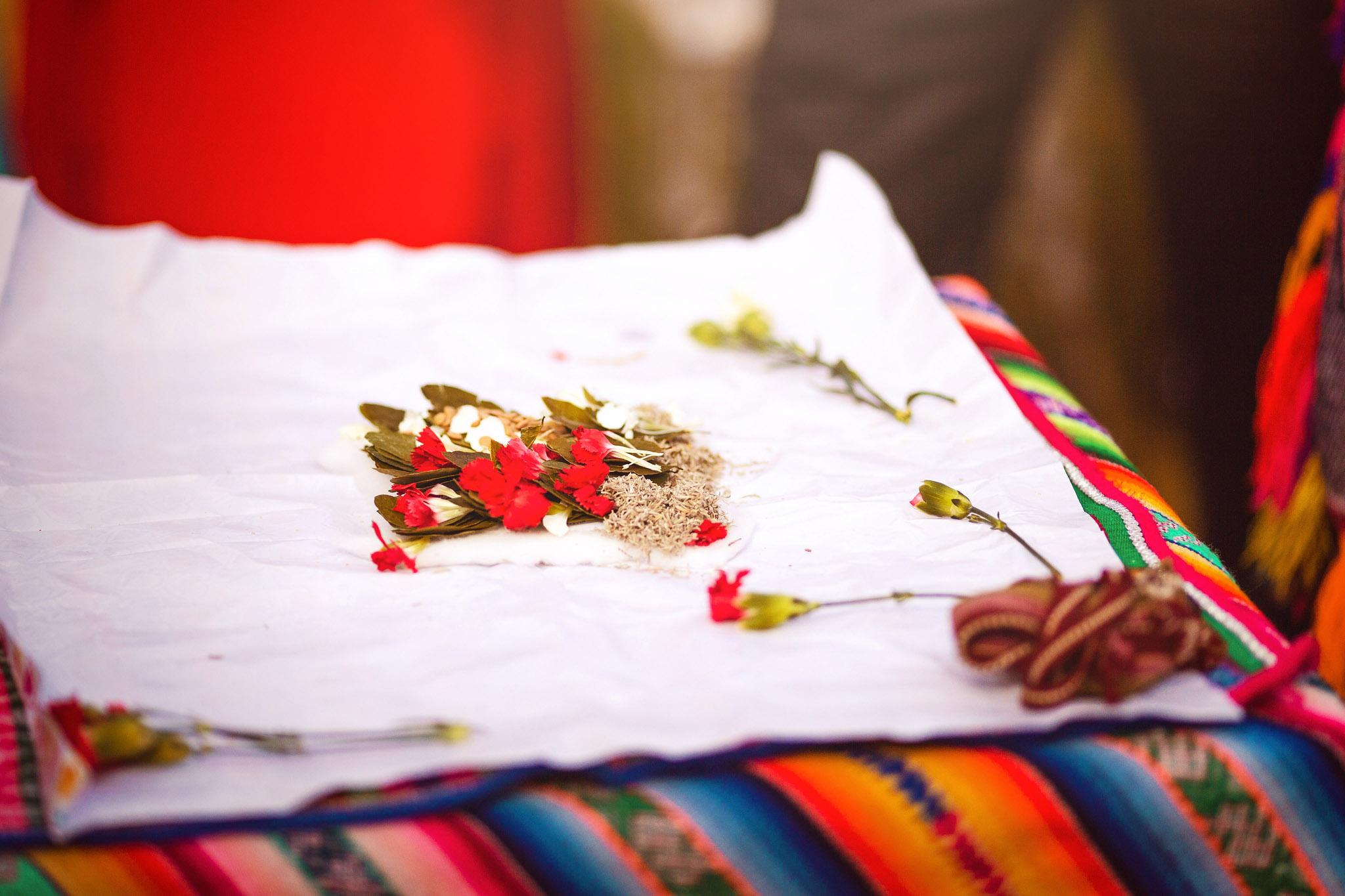 Wedding-Travellers-Destination-Wedding-Peru-Cusco-Hacienda-Sarapampa-Sacred-Valley-traditional-andean-ceremony-despacho-red-white-flower