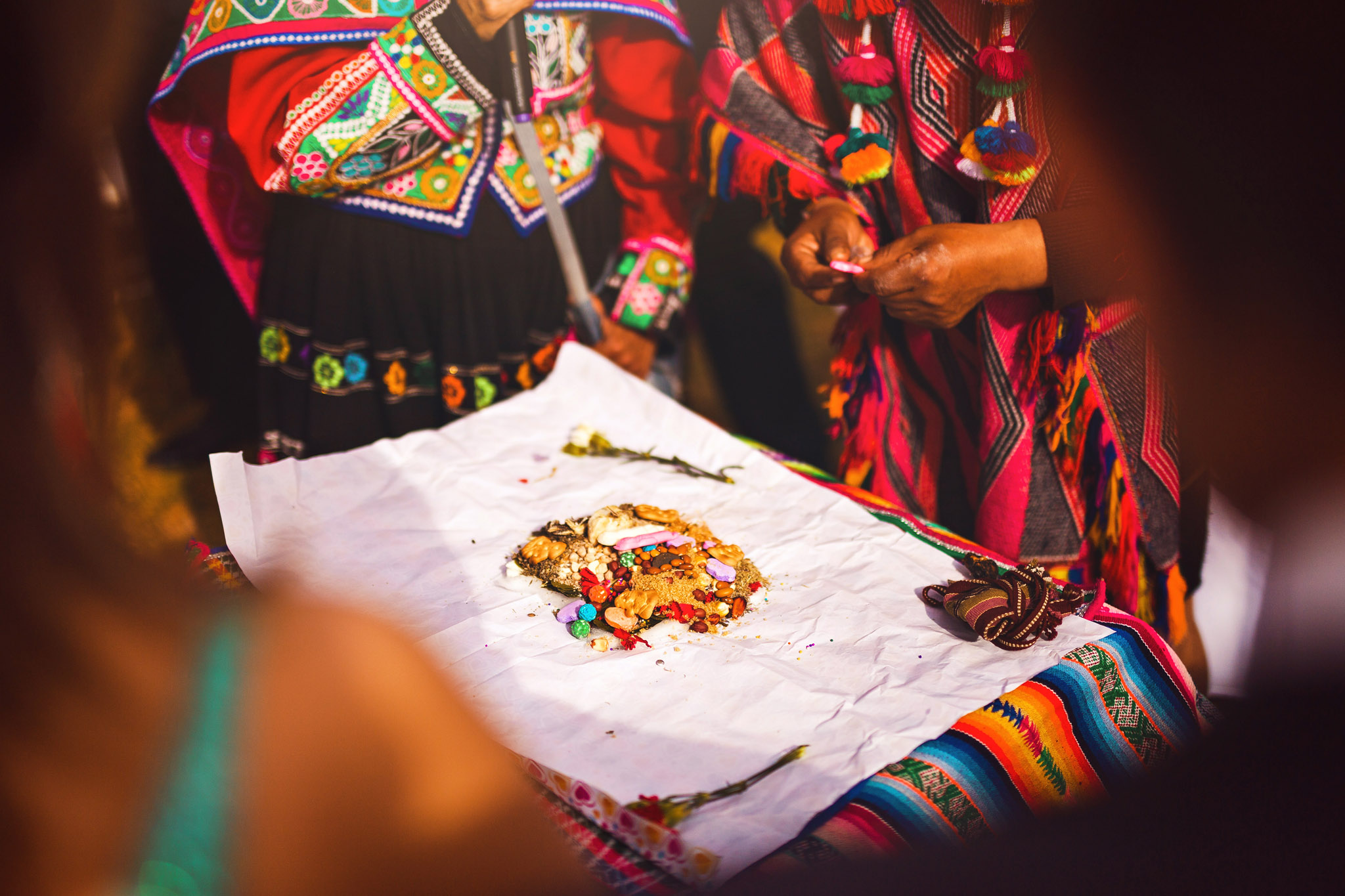 Wedding-Travellers-Destination-Wedding-Peru-Cusco-Hacienda-Sarapampa-Sacred-Valley-traditional-andean-ceremony-preparing-despacho-offer-mother-earth-pachamama