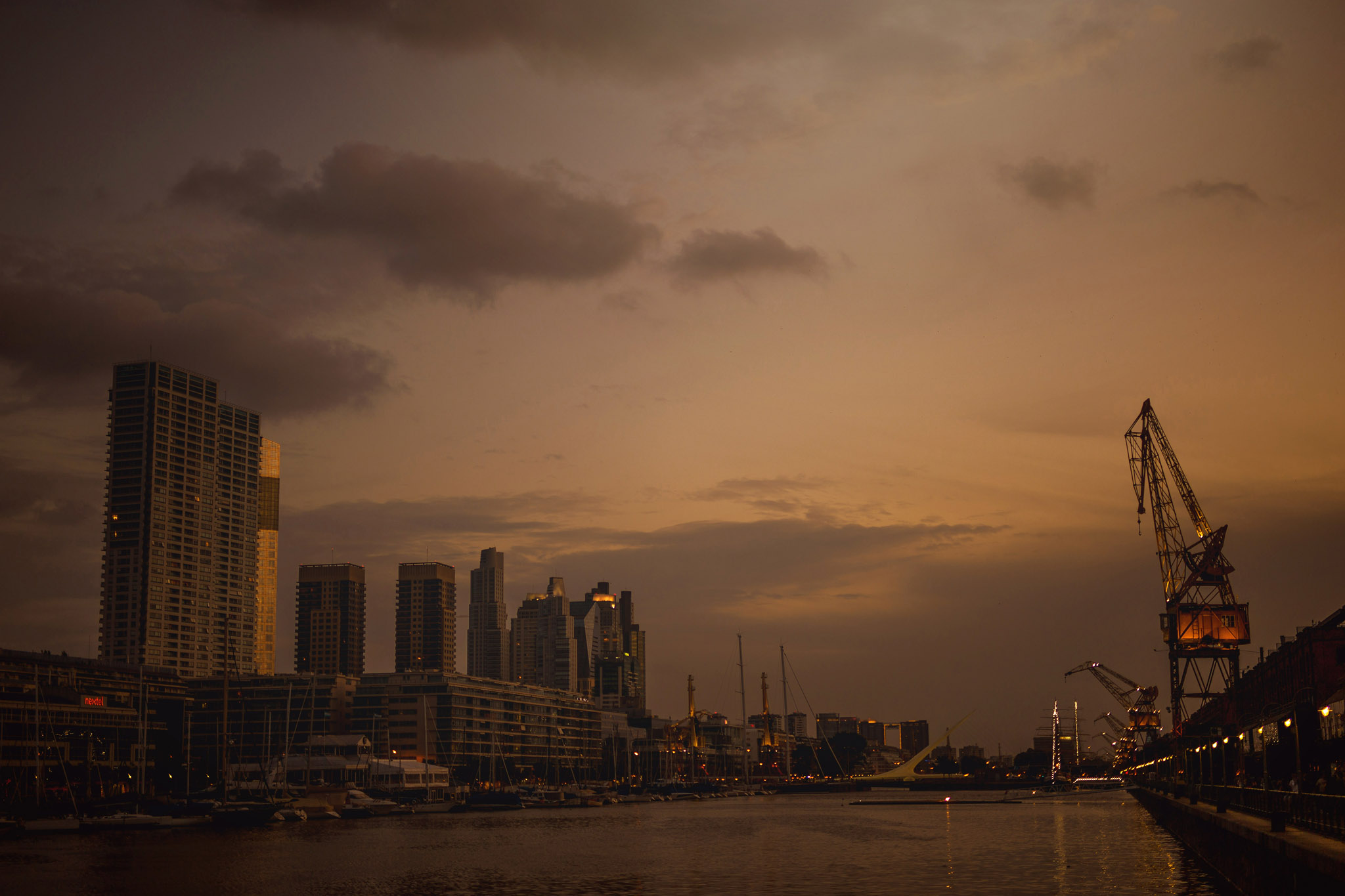 Argentina-Buenos-Aires-river-sunset-bridge-industrial-modern-puente-mujer