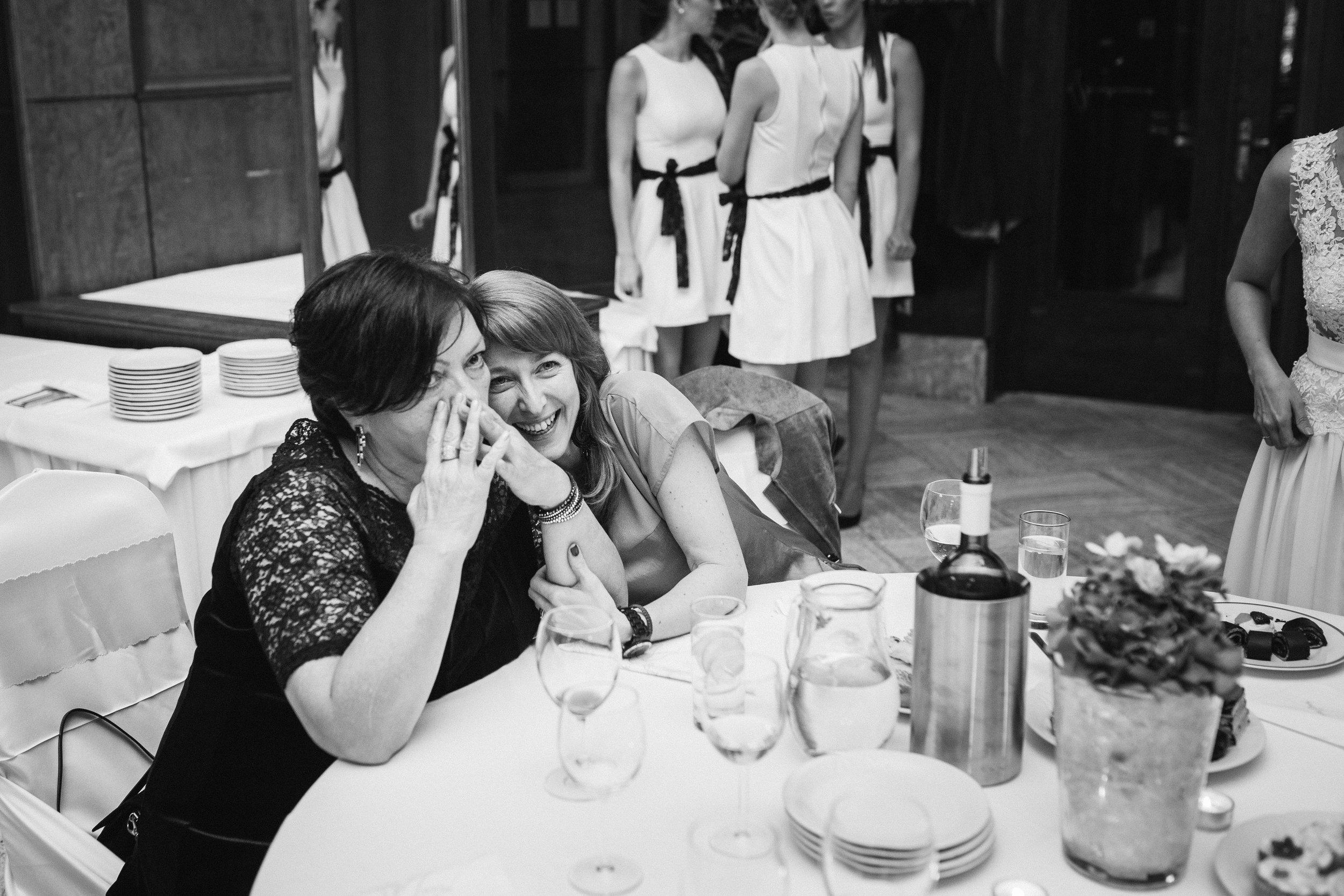destination-wedding-photographer-slovakia-bratislava-bw-laughing-guests-documentary-style.jpg