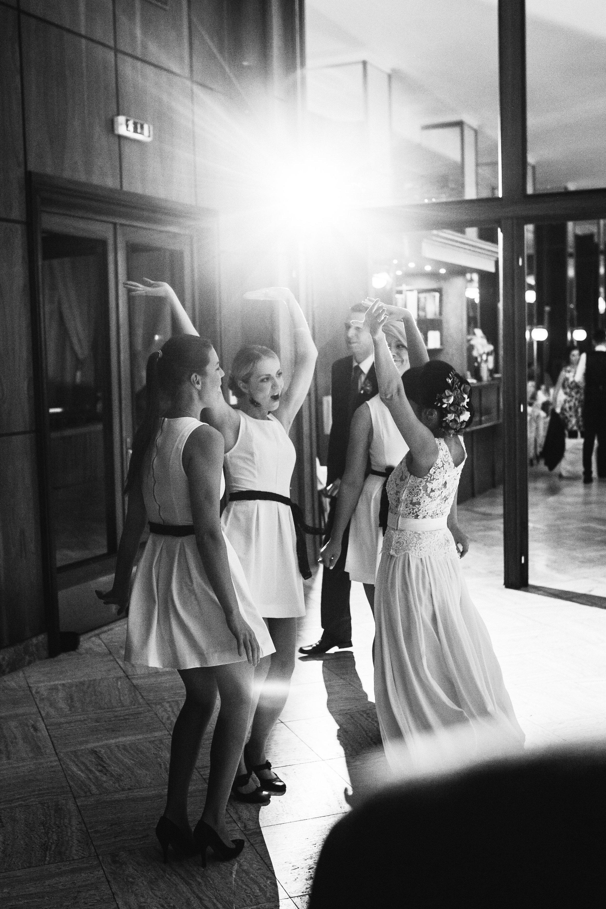 destination-wedding-photographer-slovakia-bratislava-bw-documentary-style-dancing-bridesmaids.jpg