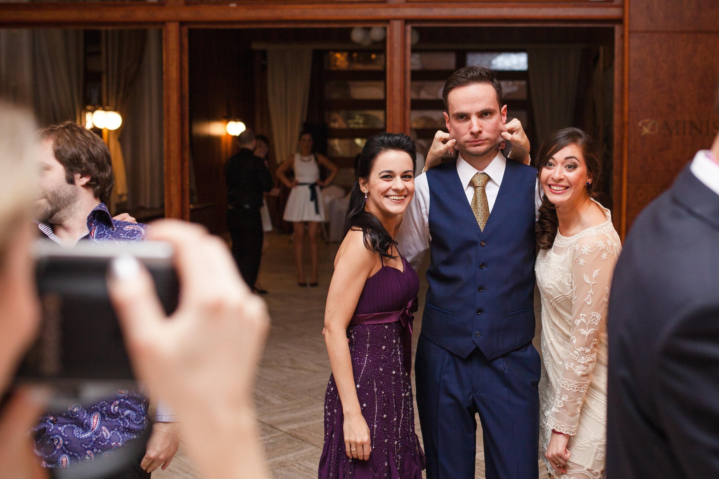 destination-wedding-photographer-slovakia-bratislava-reception-guests-fun-groom.jpg
