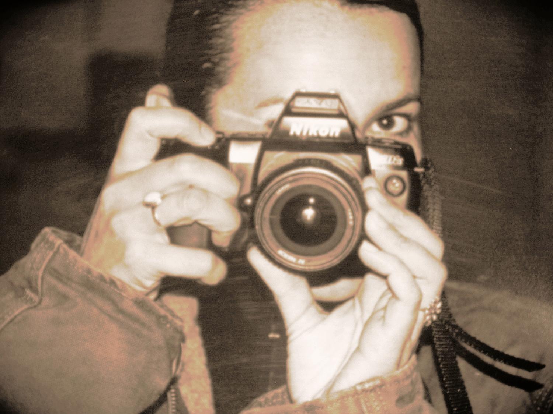 Fran portrait with camera.JPG