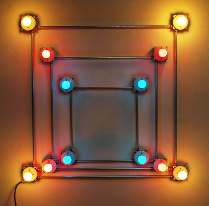 Conduits in Red, Yellow and Blue, 2012  .   Galvanized steel, copper wire, porcelain fixtures and ceramic coated light bulbs.