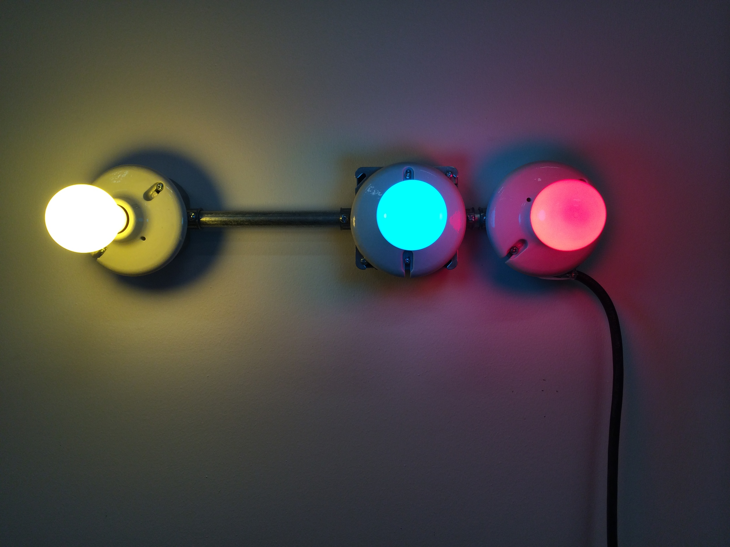 Conduits in Red, Yellow and Blue (Figure 29)  , 2014. Galvanized steel, copper wire, porcelain fixtures and ceramic coated light bulbs.