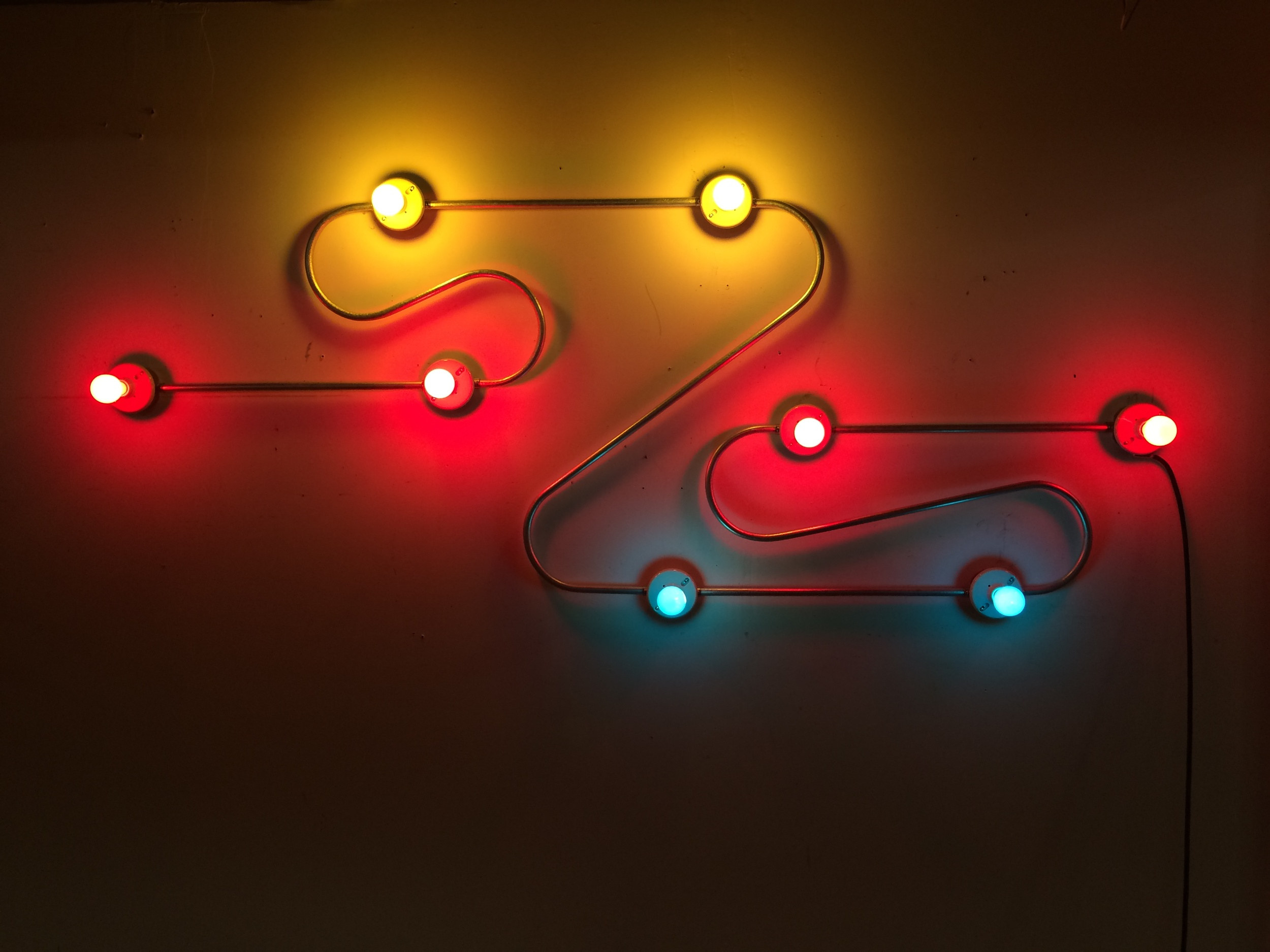 Constellation in Red, Yellow and Blue (Figure 9) , 2014. Galvanized steel, copper wire, porcelain fixtures and ceramic coated light bulbs.