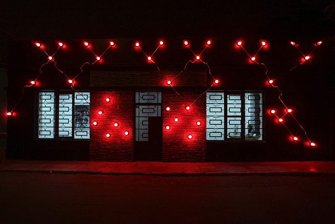 Constellation in Red (Figure 8)  , 2014.   Galvanized steel, copper wire, porcelain fixtures and ceramic coated light bulbs. Facade of Revolver Galeria, Lima, Peru.