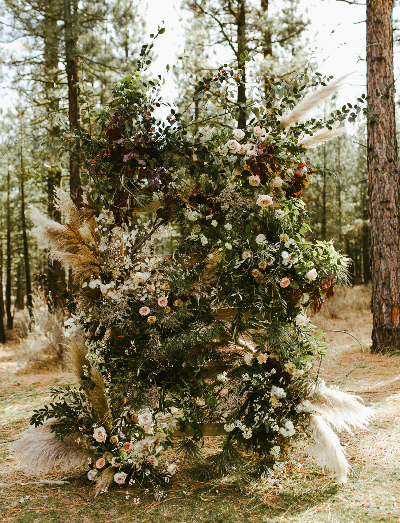 Amazing floral backdrop created by the bride's sister ( Aubriana of The Bloomery Co. )