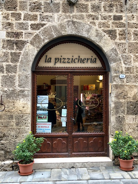 The little market: hand-carved prosciutto, local cheese, local wine, bread, and an entire section devoted to truffles.