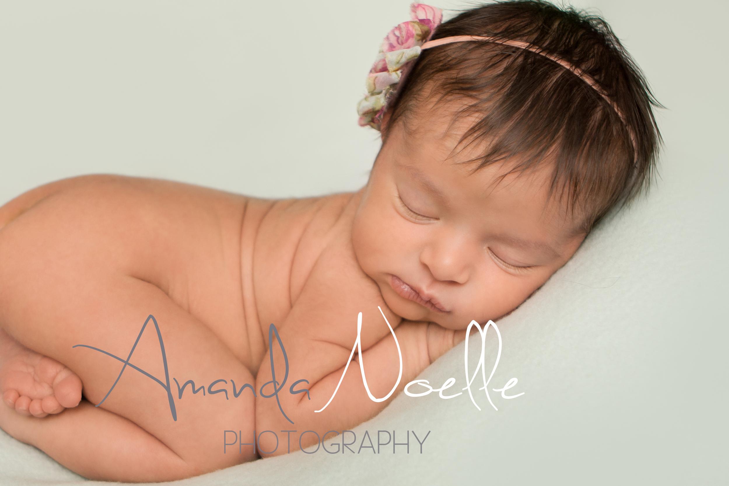 Newborn baby girl sleepingwith shabby chic pink  headband on teal mint aqua fabric backdrop, tushy upbeanbag pose, Westchester, County New York Newborn Photographer, Amanda Noelle Photography.