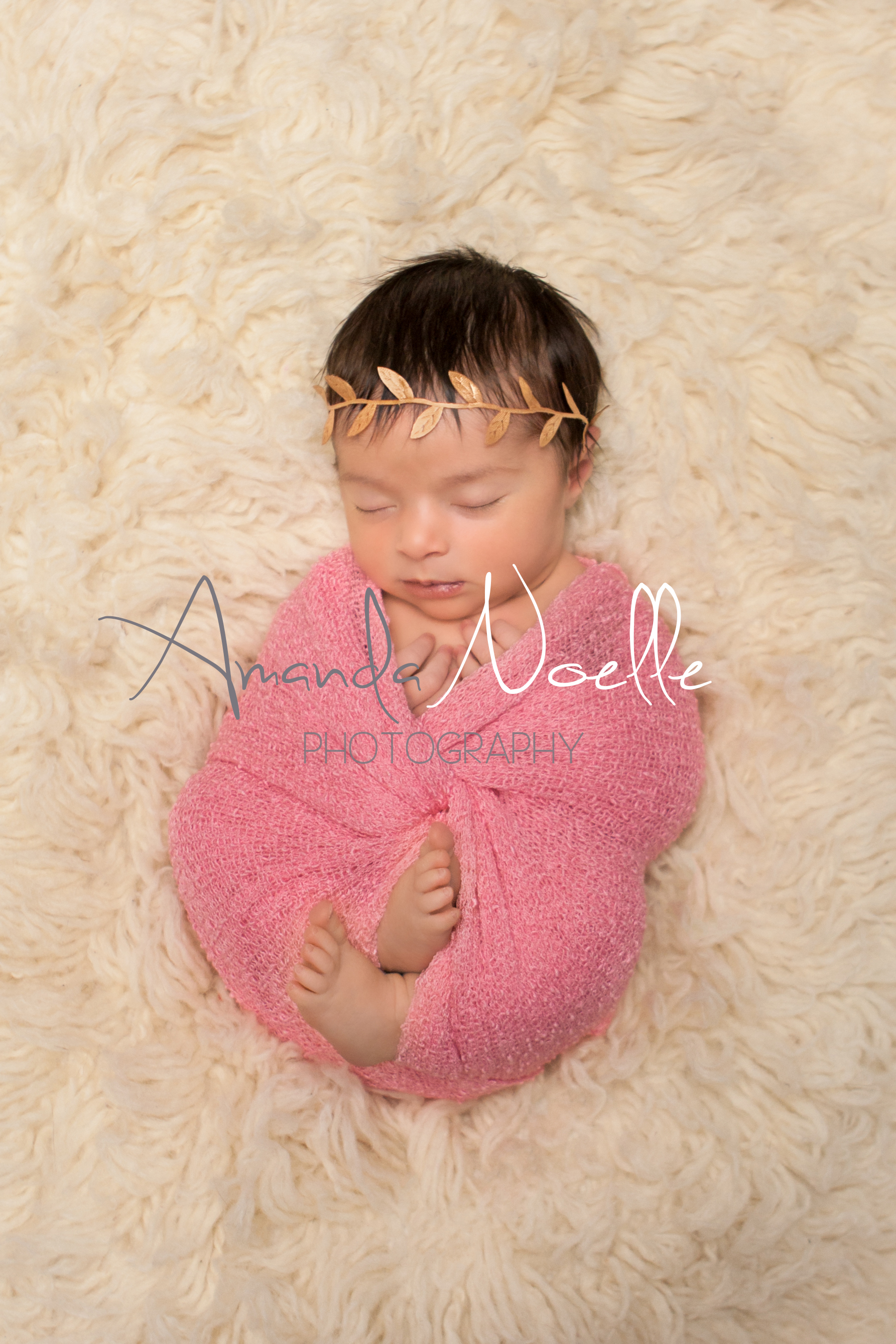 Newborn baby girl sleeping with gold leaf   headband wrapped in stretch knit pink wrap on cream creme flokati rug, Westchester, County New York Newborn Photographer, Amanda Noelle Photography.