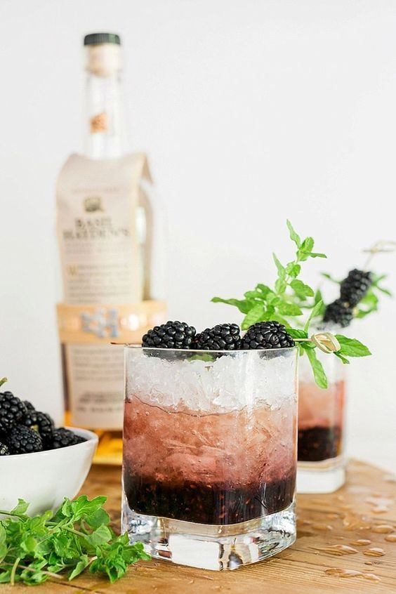 "BLACKBERRY BOURBON SMASH - Ingredients: (Serves 1)2 ounces bourbon1/2 ounce lime juice, or 2 lime wedges, squeezed6–7 mint leaves, muddled2–3 blackberries, muddled3/4 ounce simple syrup (1 tablespoon of sugar will do)1 ounce club sodaiceInstructions:combine all ingredients into a cocktail shaker except for the soda water, ice & bourbon. Muddle until everything is ""Smashed"" Add bourbon, ice and shake vigorously for 15 seconds.Empty all ingredients into a rocks glass without straining and add a 1oz soda topper. Stir and garnish with a fresh mint sprig and add blackberry on a pick."