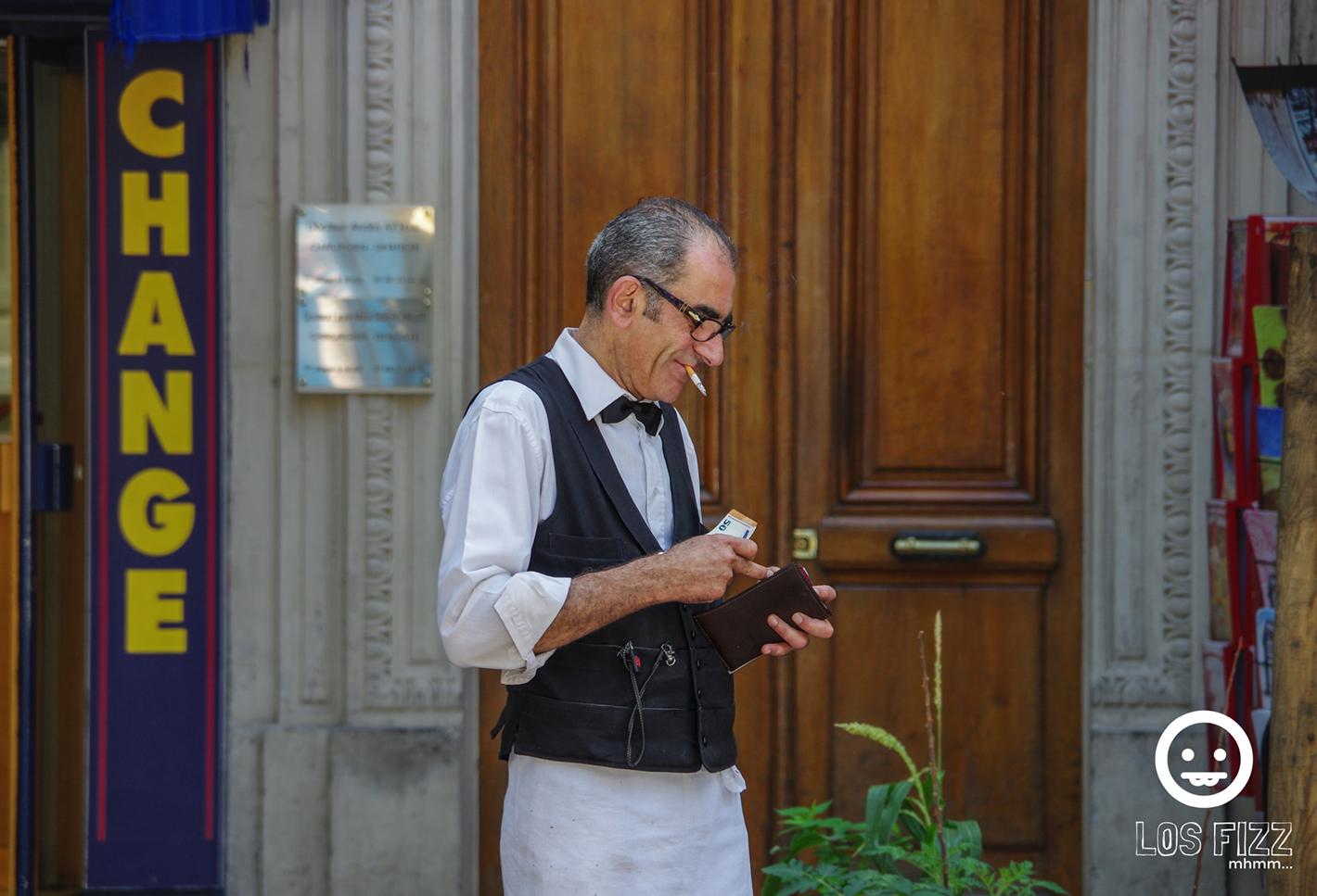 Waiter outside of Parisian restaurant near Notre Dame Photo By LosFizz.