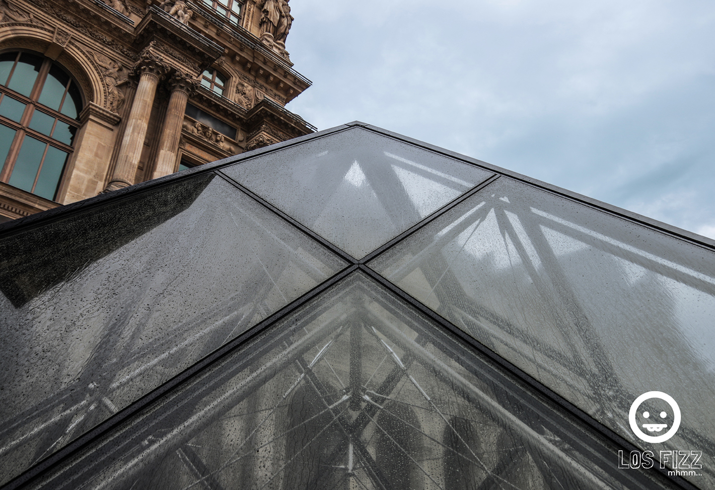Small glass pyramid at the Louvre in Paris, France. Photo By LosFizz.