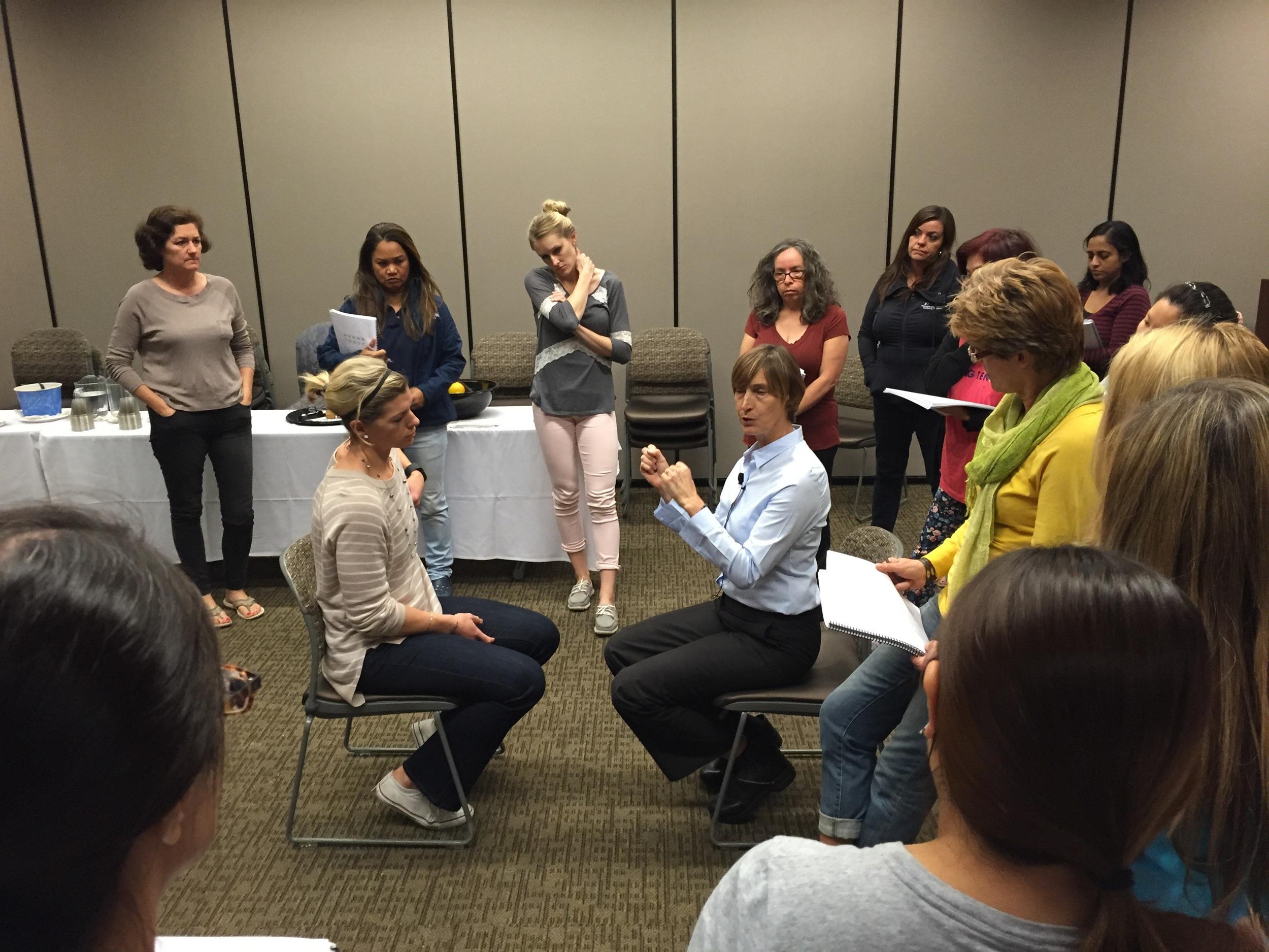 Wendy Wood center teaching the eye exam and vestibulo occular reflex portion of the class.