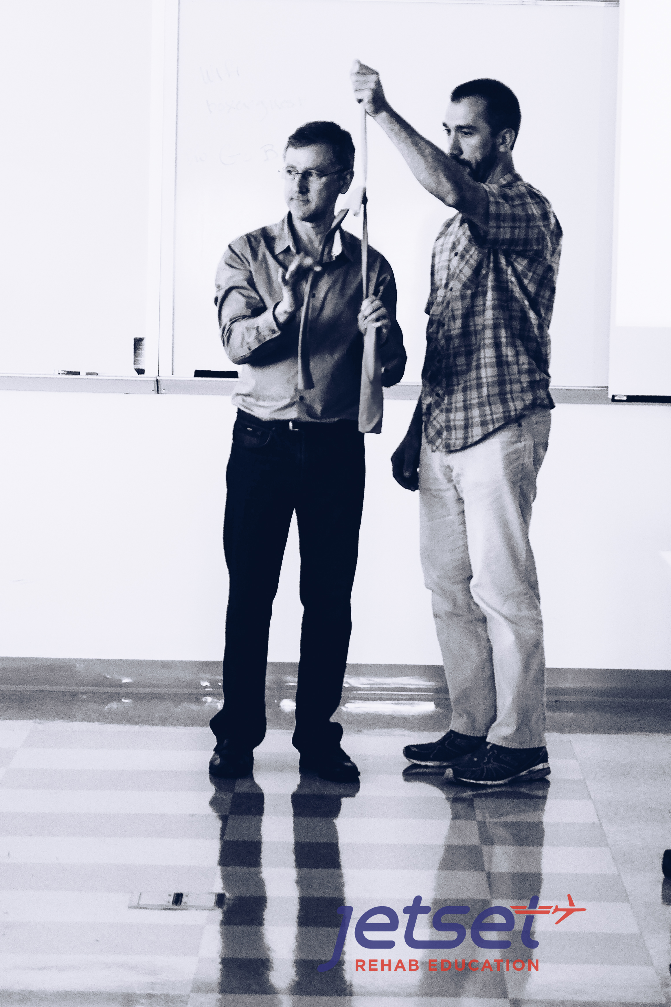 We start the morning learning how tension on a contralateral nerve can take the tension off of a painful nerve. See the video below where Michael Shacklock (left) explains this concept.