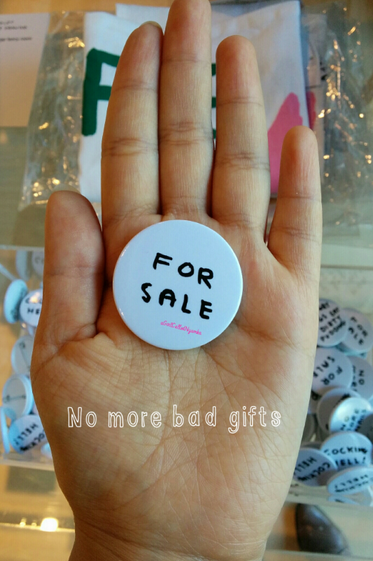 The button art is by David Shrigley.
