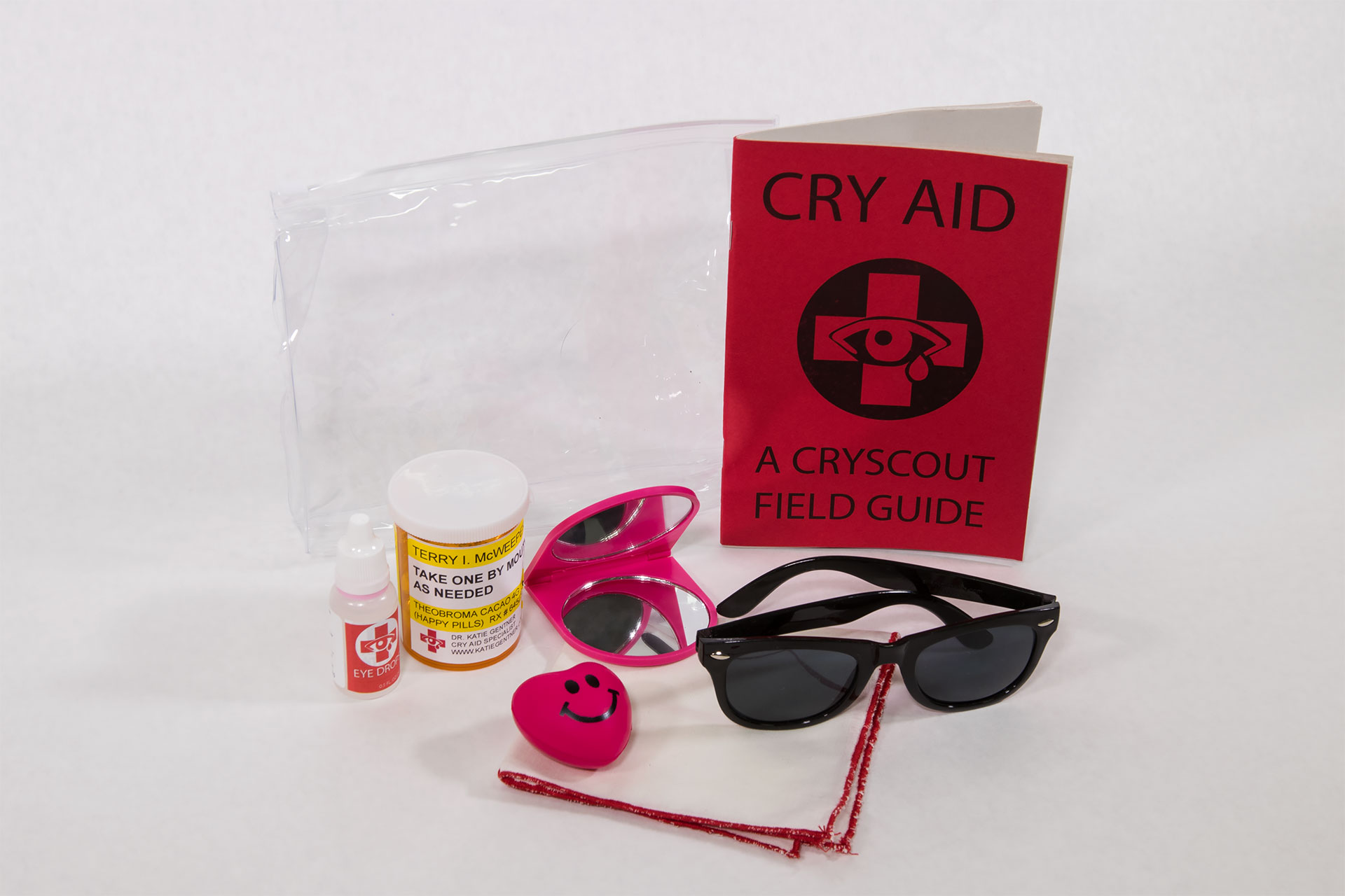 "Cry Aid Kit   Cry Aid Field Guide, hankie, happy pills, eye drops, hand mirror, sunglasses, stress ball, carrying case.  6"" x 7.5"" x 2""  2017   $29.99   Available on Etsy"