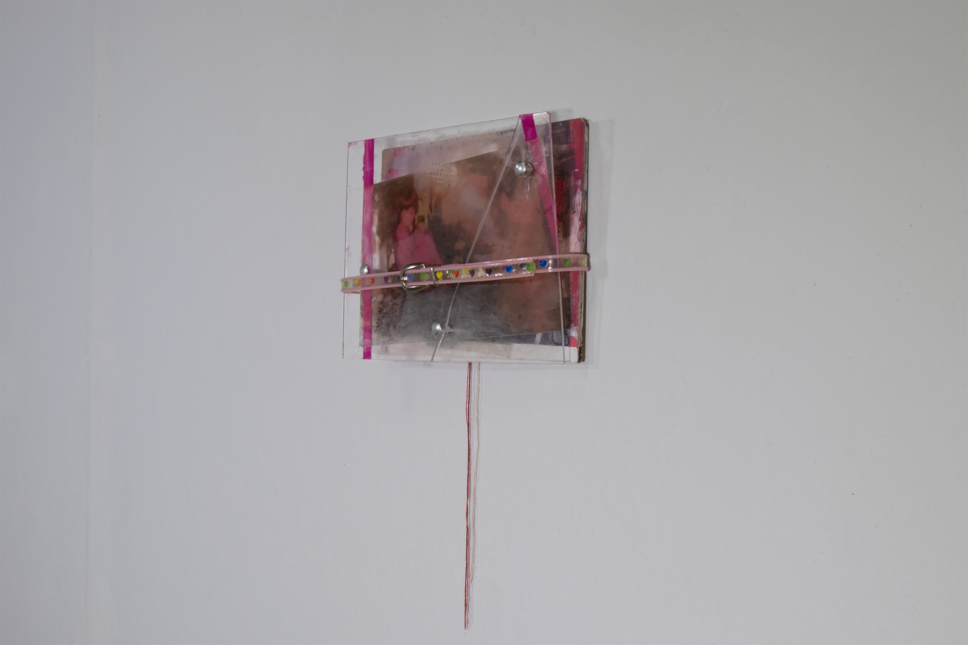 """She's Being a Brat   acrylic on panel and plexiglass, embroidery floss, belt.  8"""" x 10"""" x 2""""  2017"""