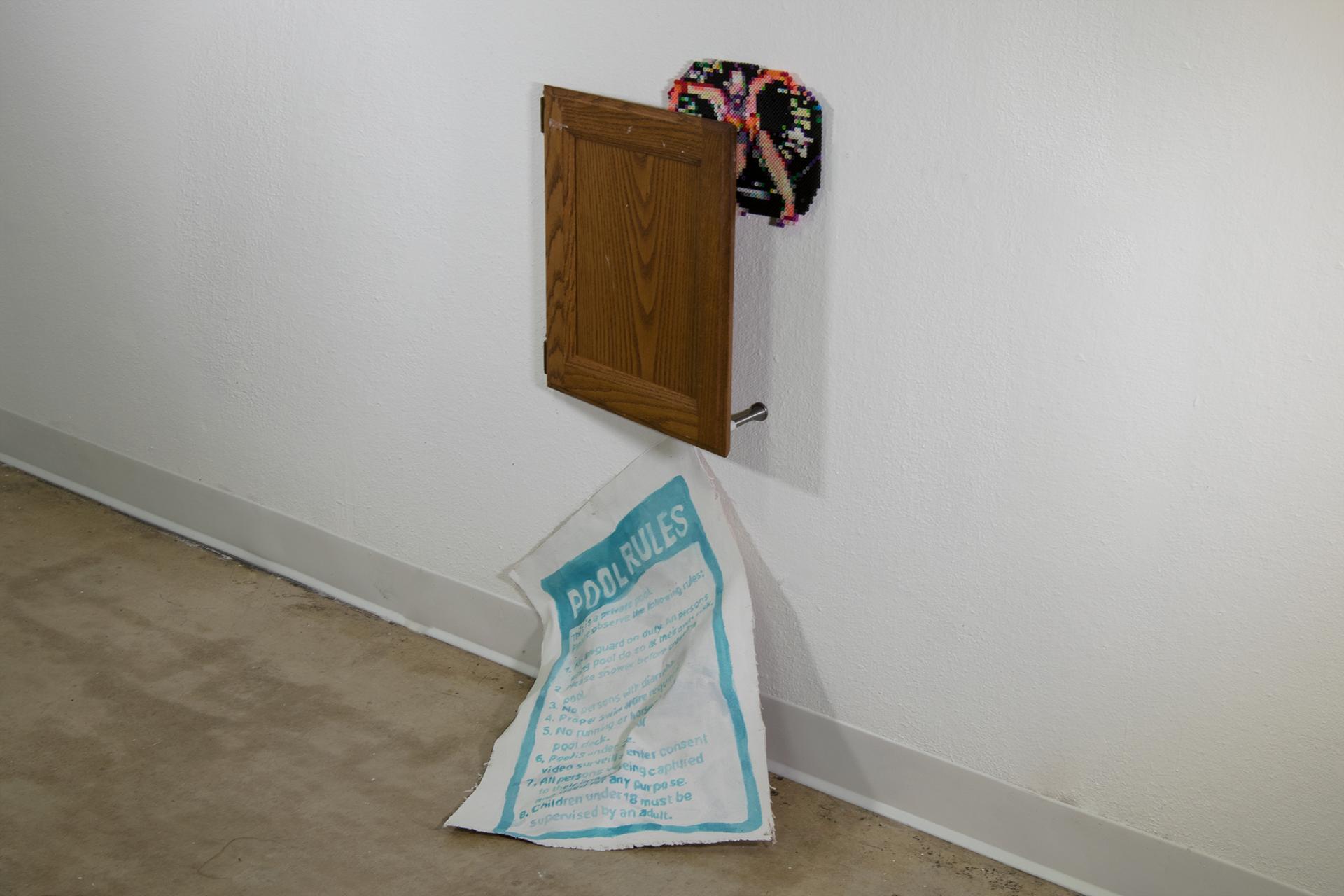 """Evacuate    wooden  cabinet door, plastic beads, acrylic on canvas, spring door stop  44"""" x 22"""" x 5""""  2017"""