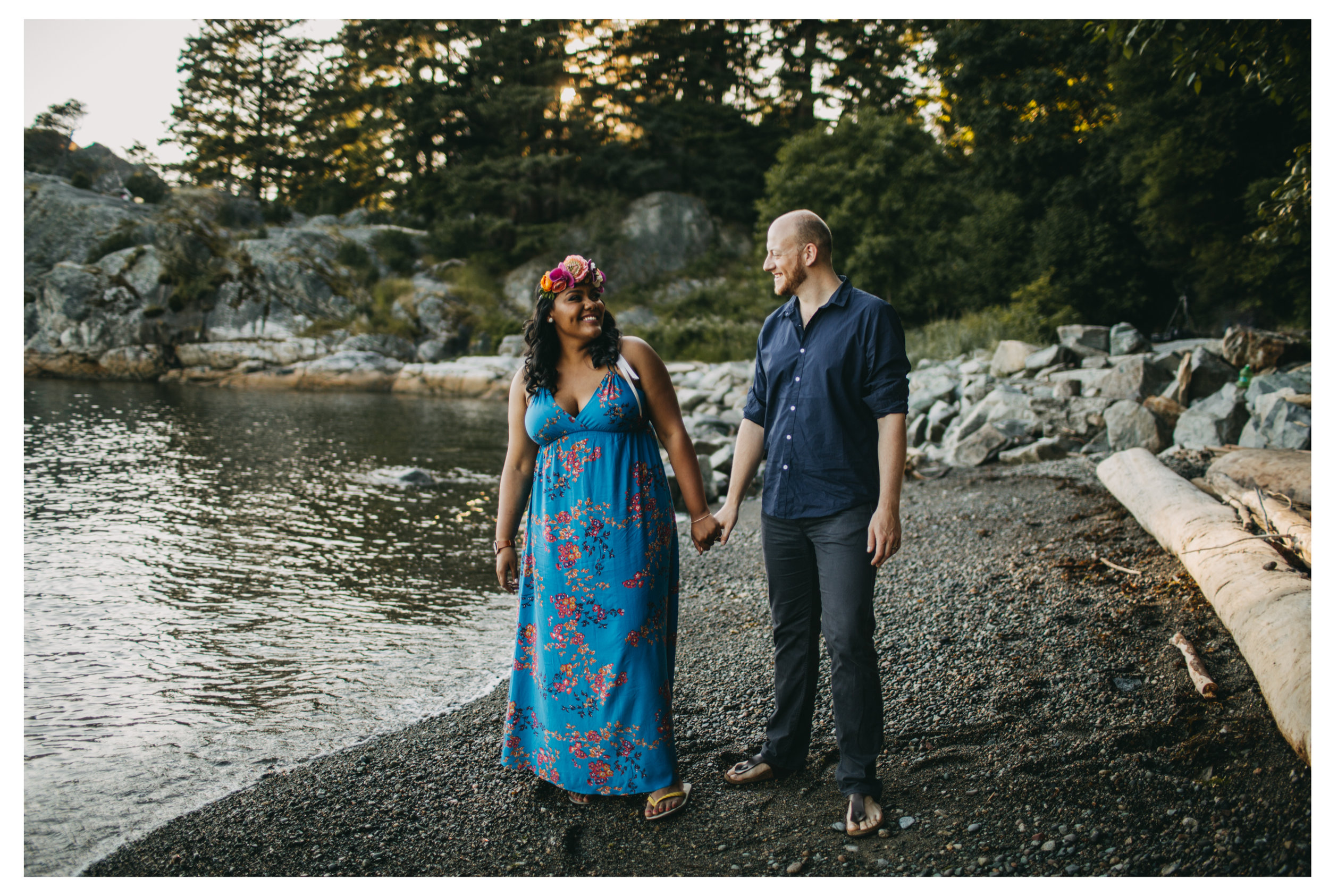 engaged couple holding hands laughing beach engagement whytecliff park sunset