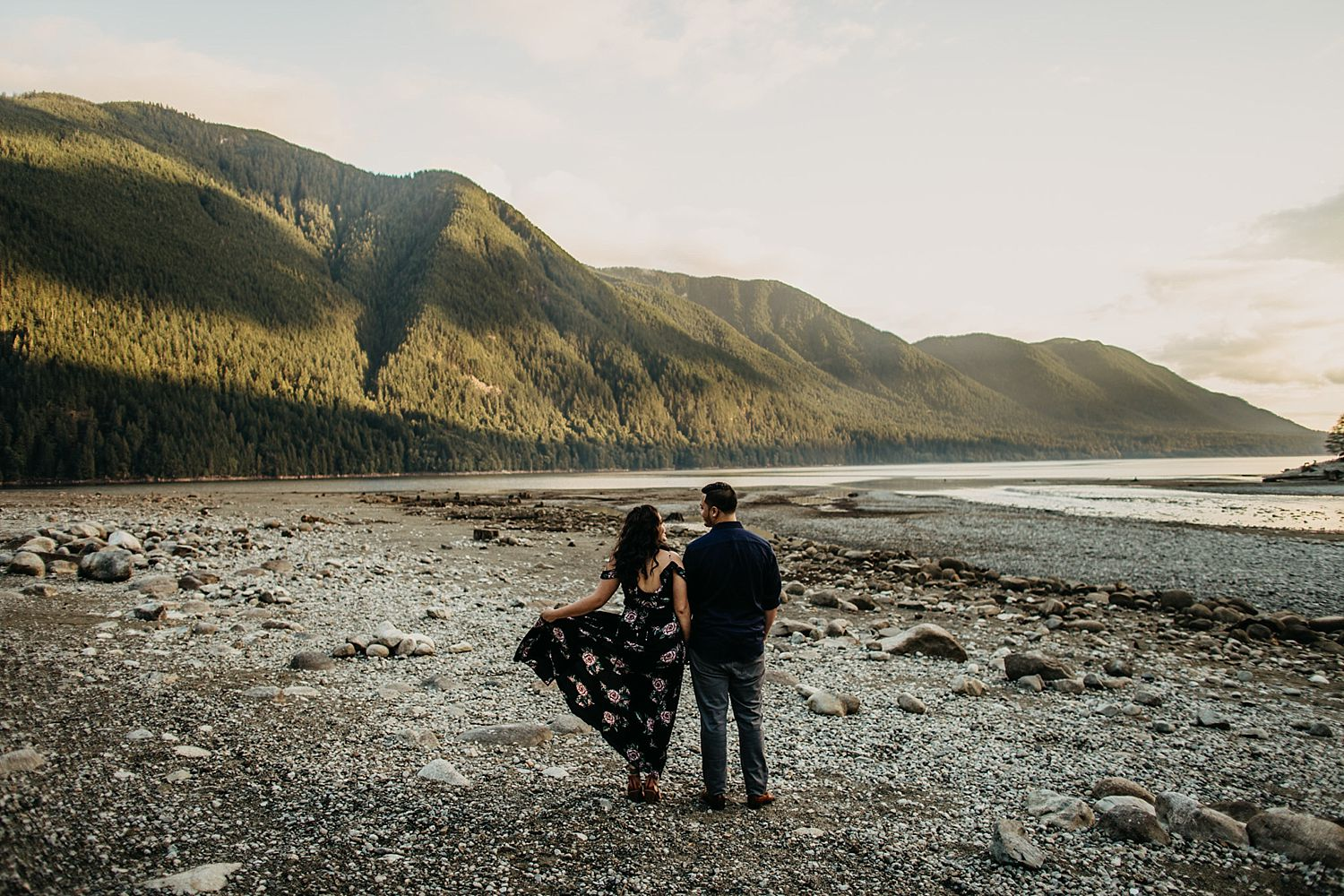 Copy of couple standing on beach alouette lake dress flowing in wind