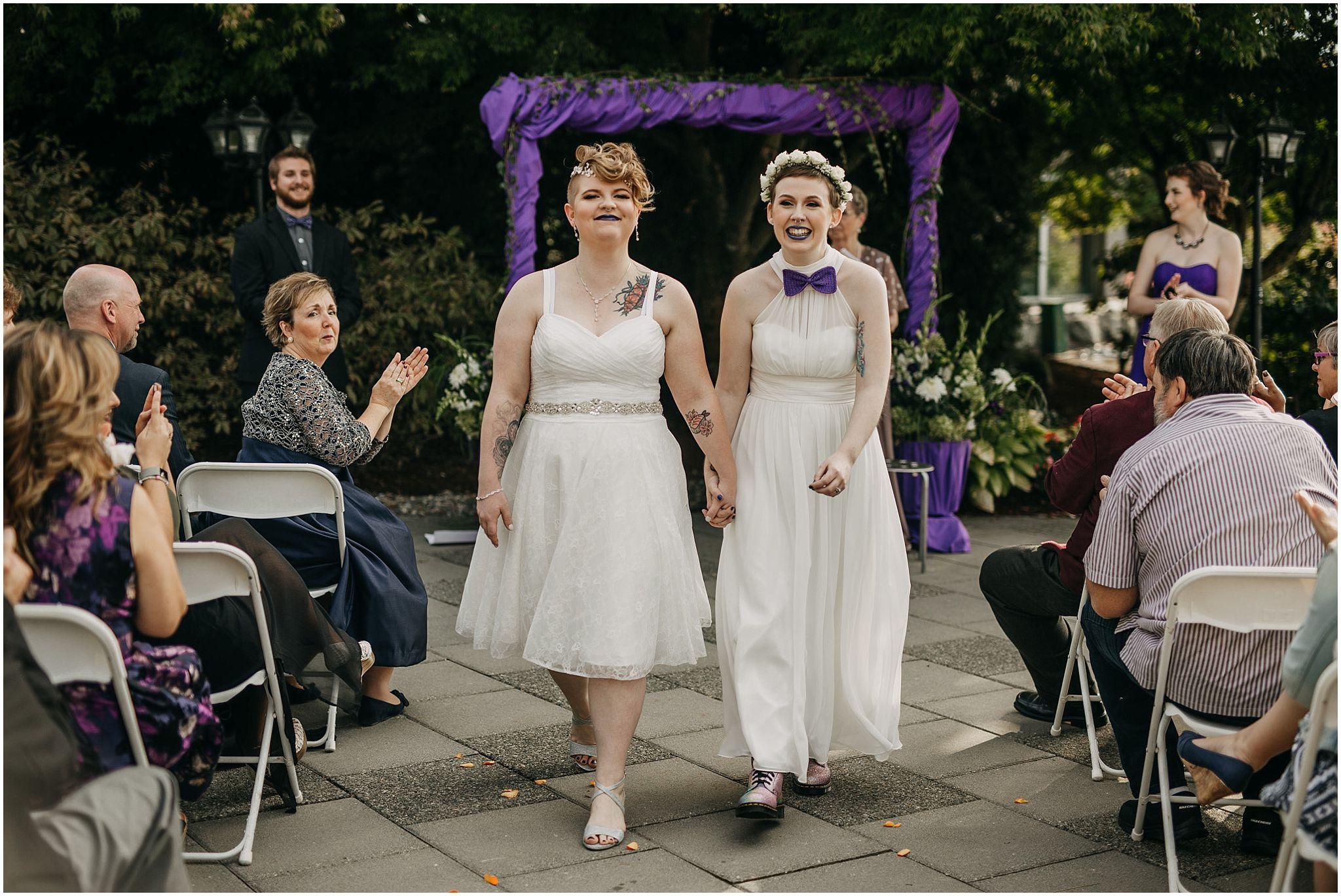 same sex couple wedding ceremony exit