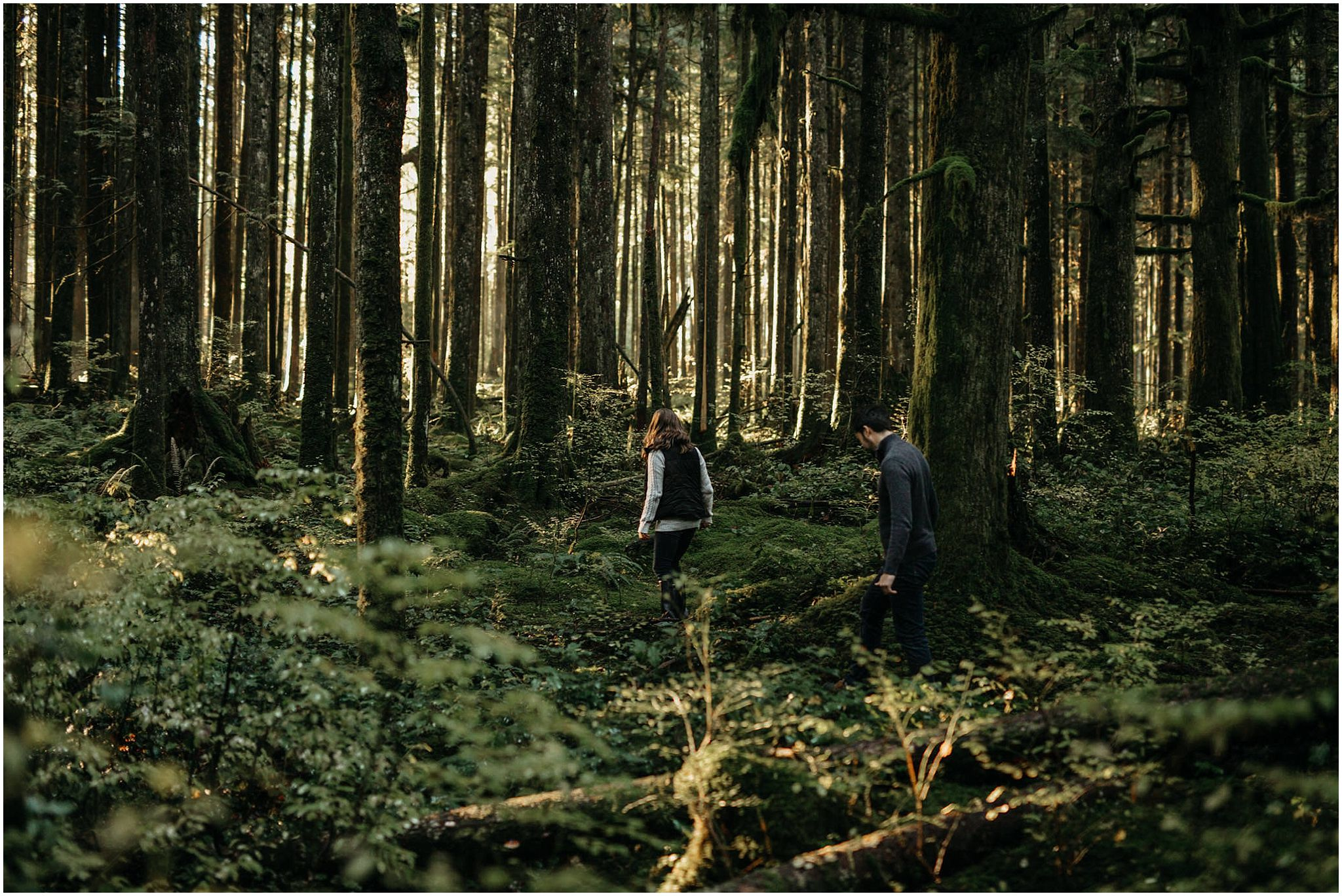 couple walking into mossy forest engagement photos