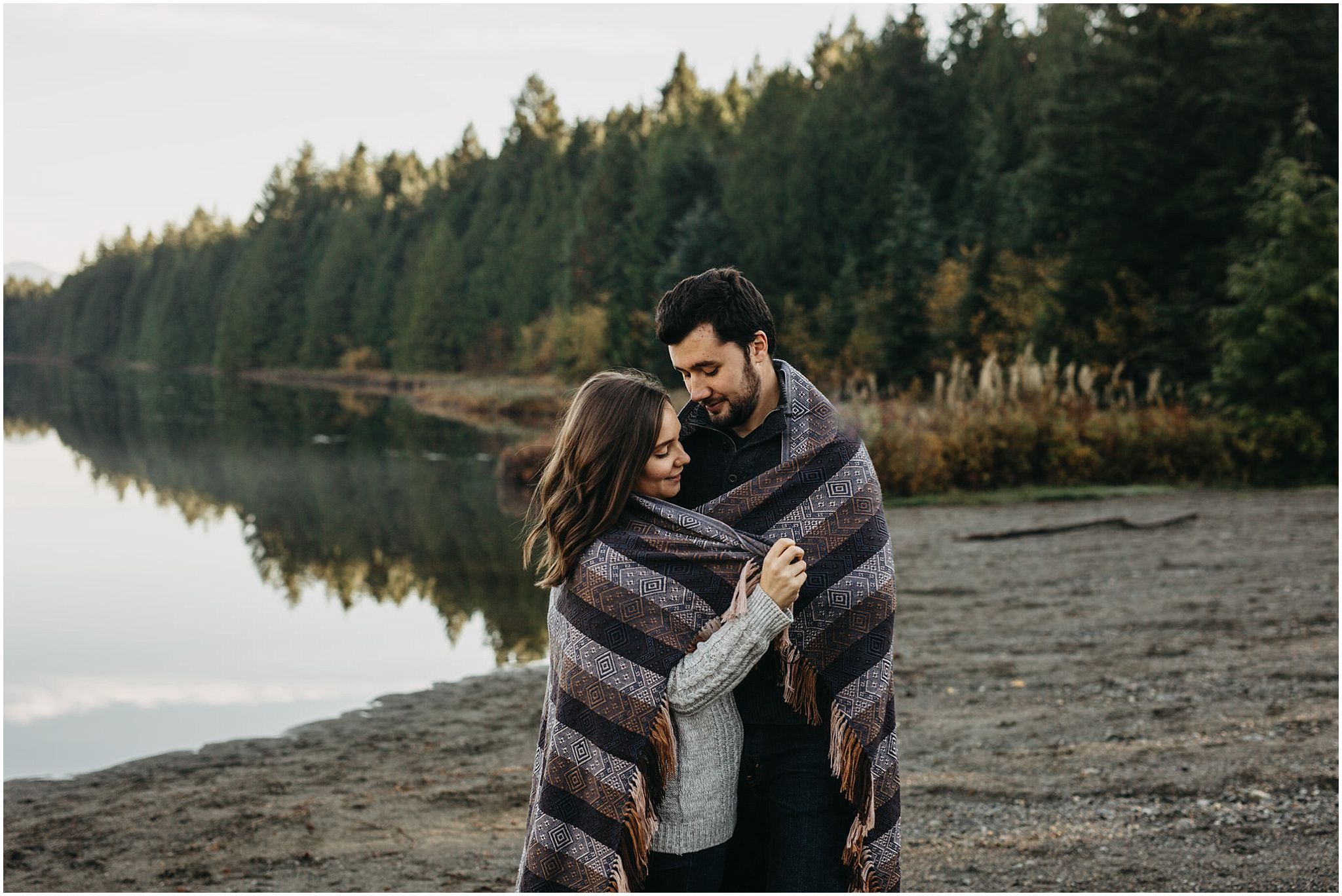couple wrapped in blanket engagement photos fall autumn