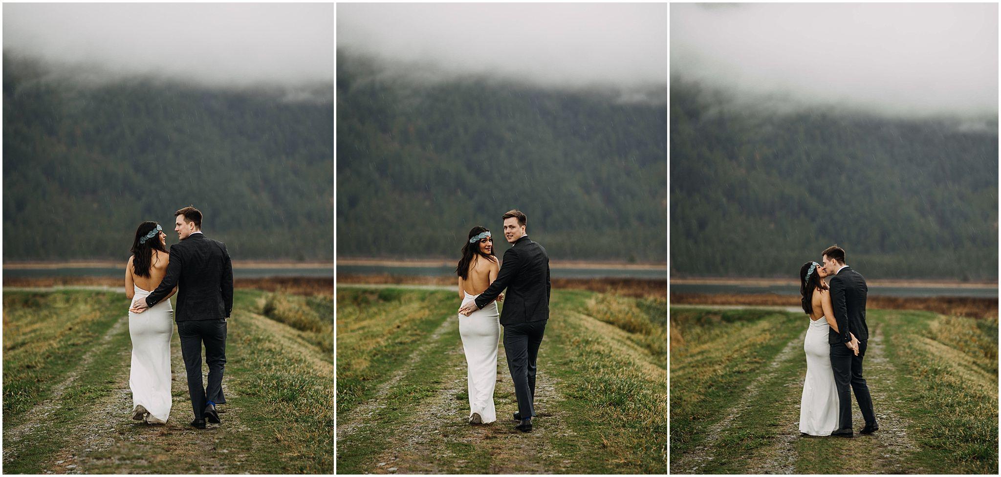 couple walking away looking back pitt lake engagement pnw