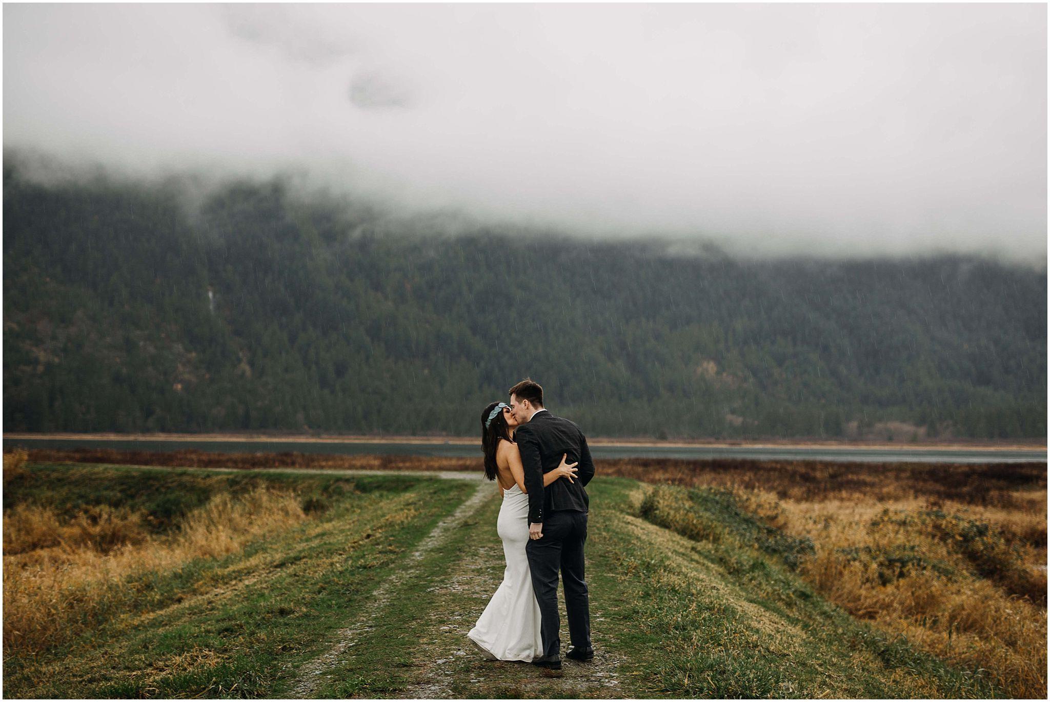 bride groom kiss pitt lake marsh foggy pnw