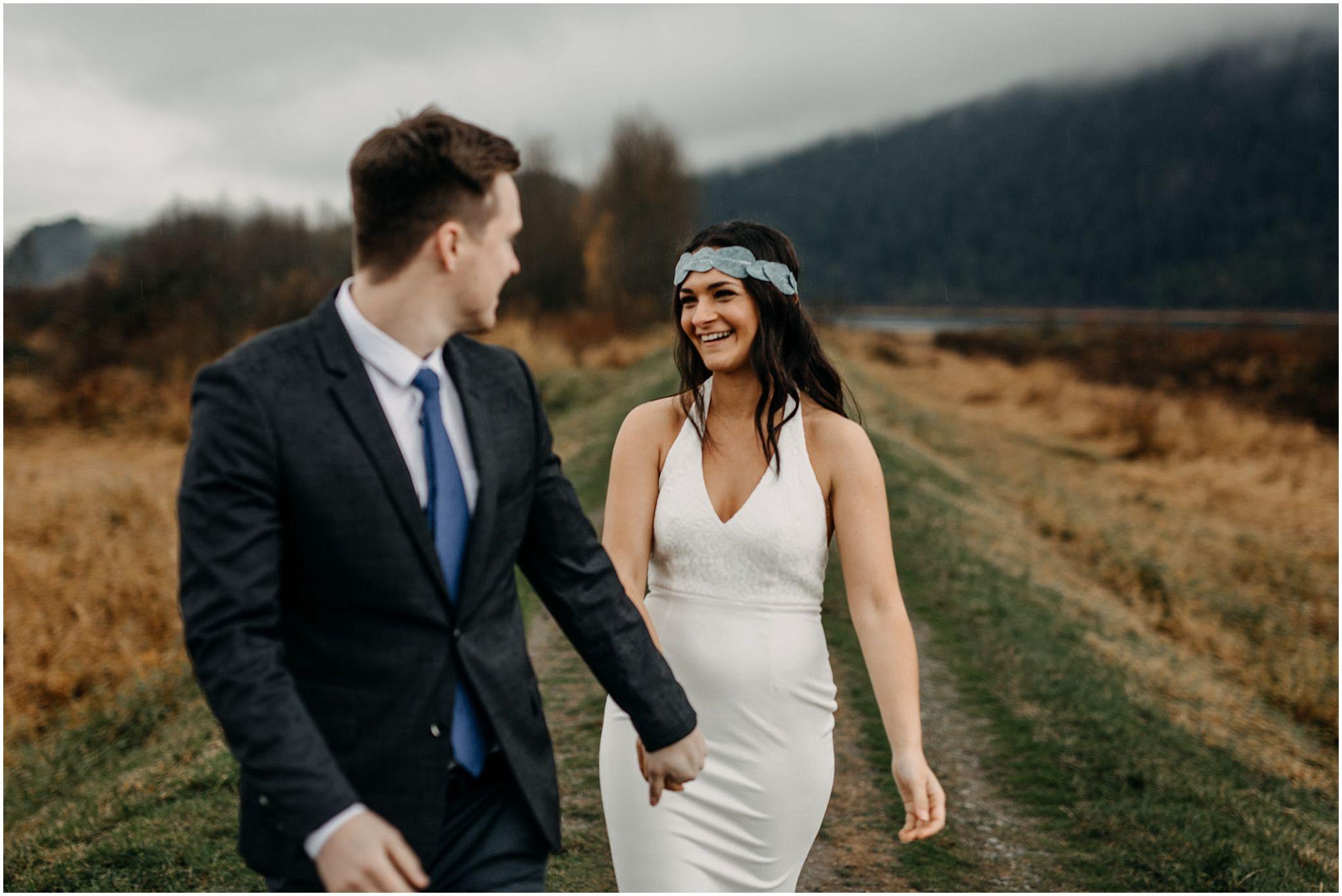 guy leading girl walk smile pitt lake marsh engagement
