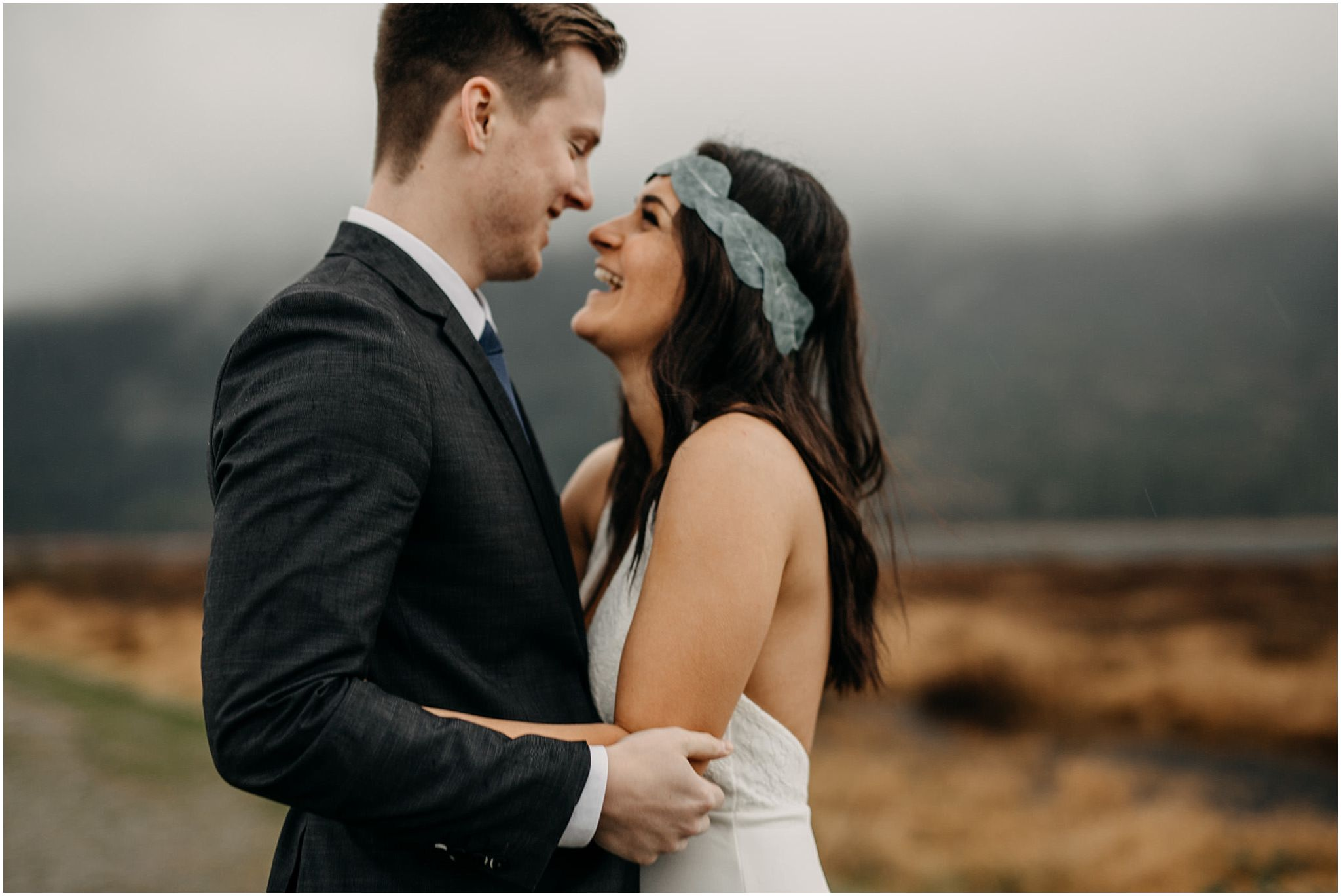 bride groom arms wrapped around each other pitt lake foggy