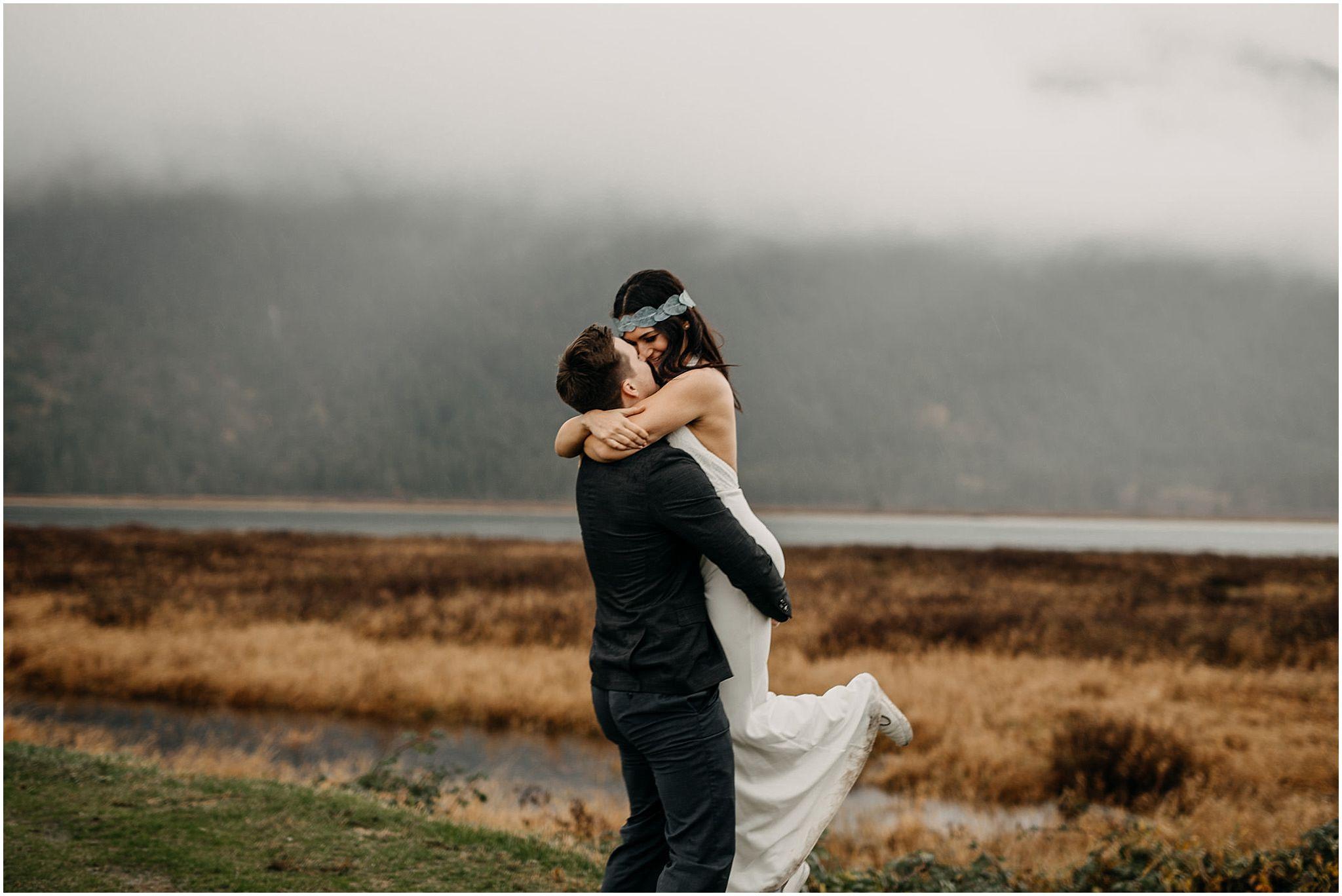 groom lifting bride pitt lake foggy portraits