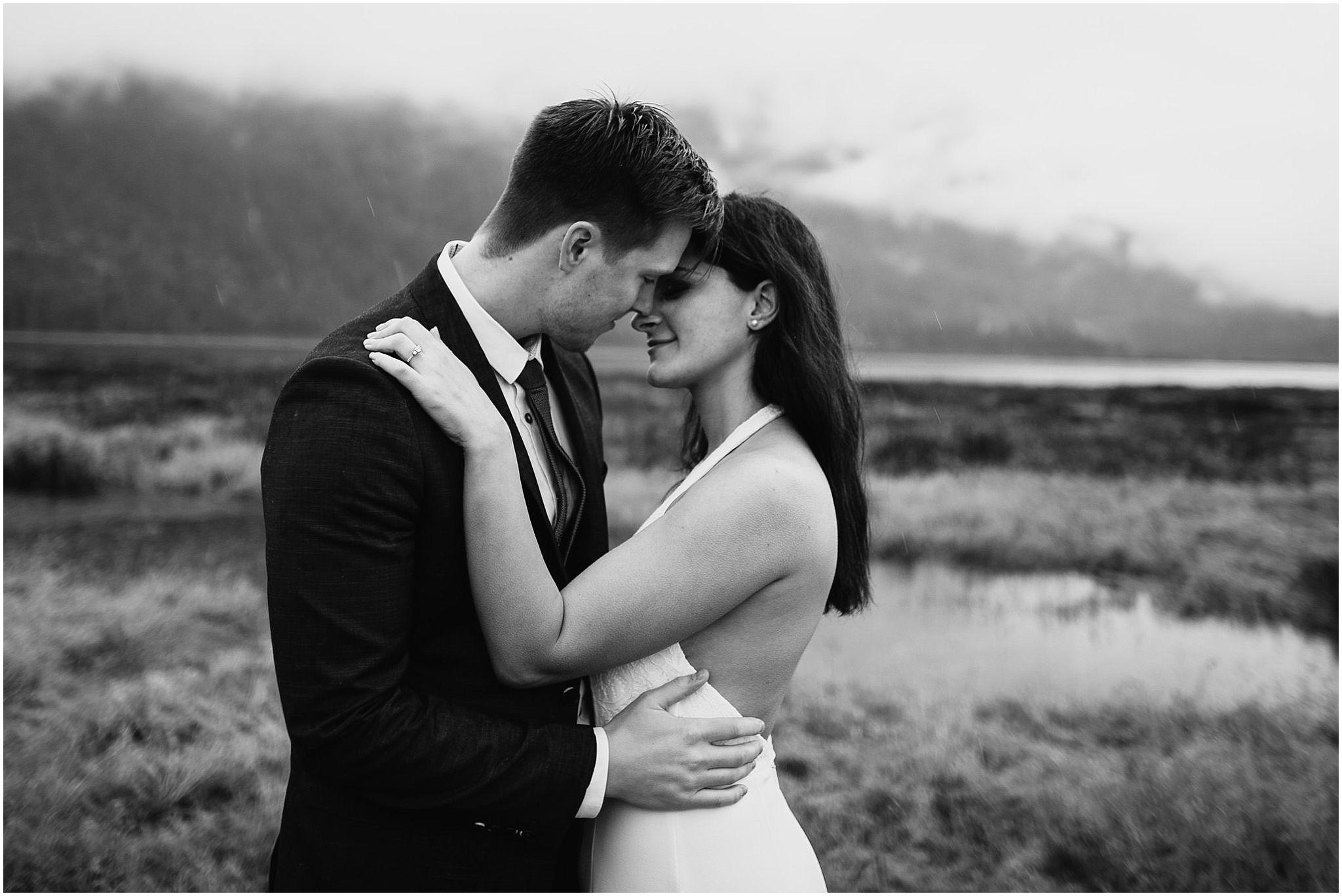 romantic moment between bride groom at pitt lake