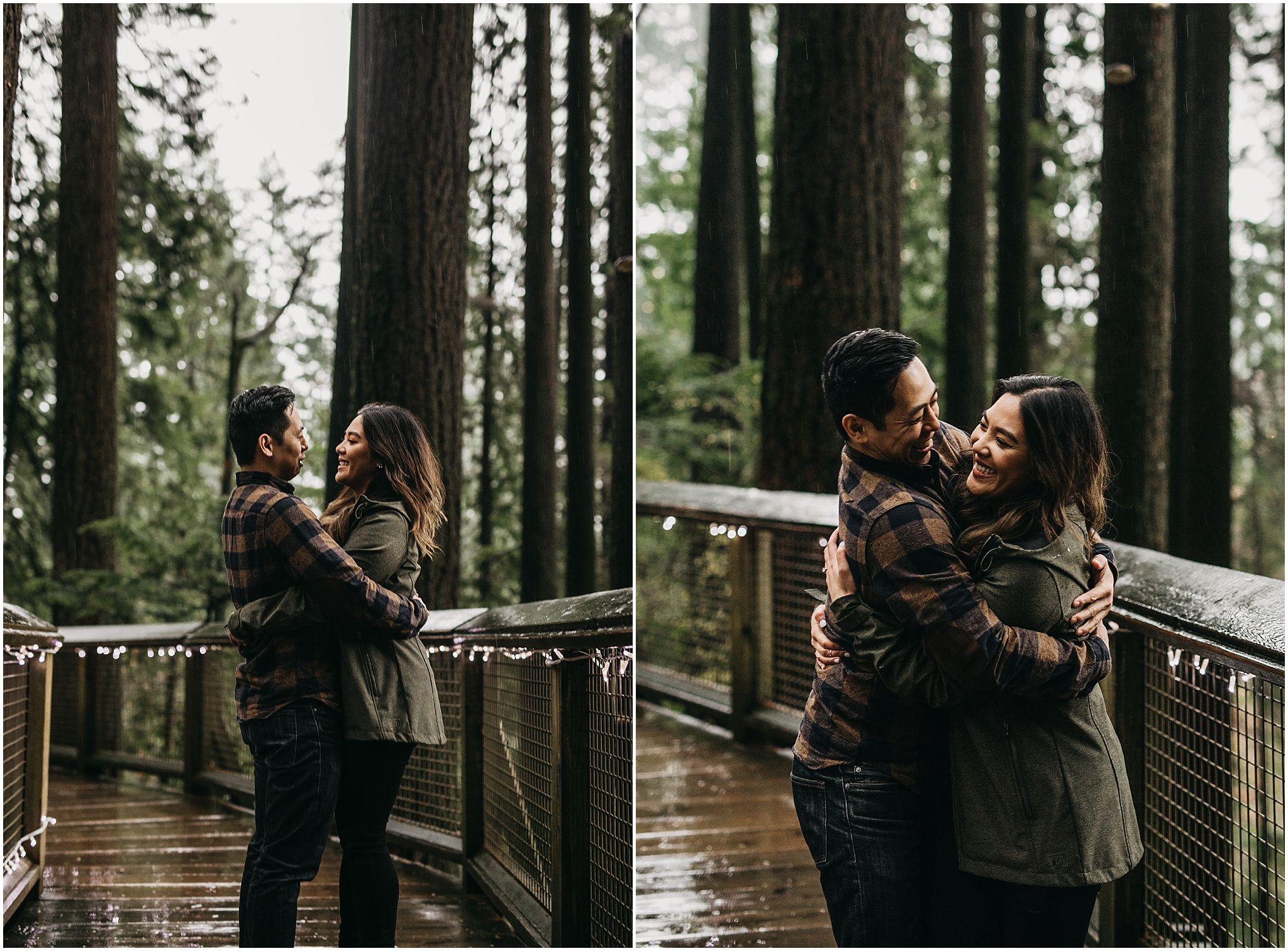 engaged couple hug capilano suspension bridge park nature walk engagement