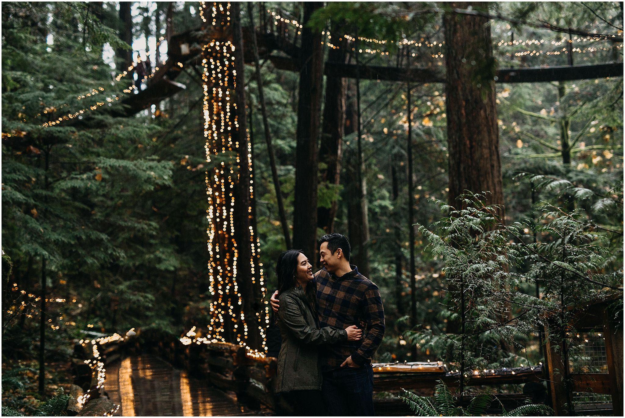 capilano suspension bridge canyon lights engagement photos couple