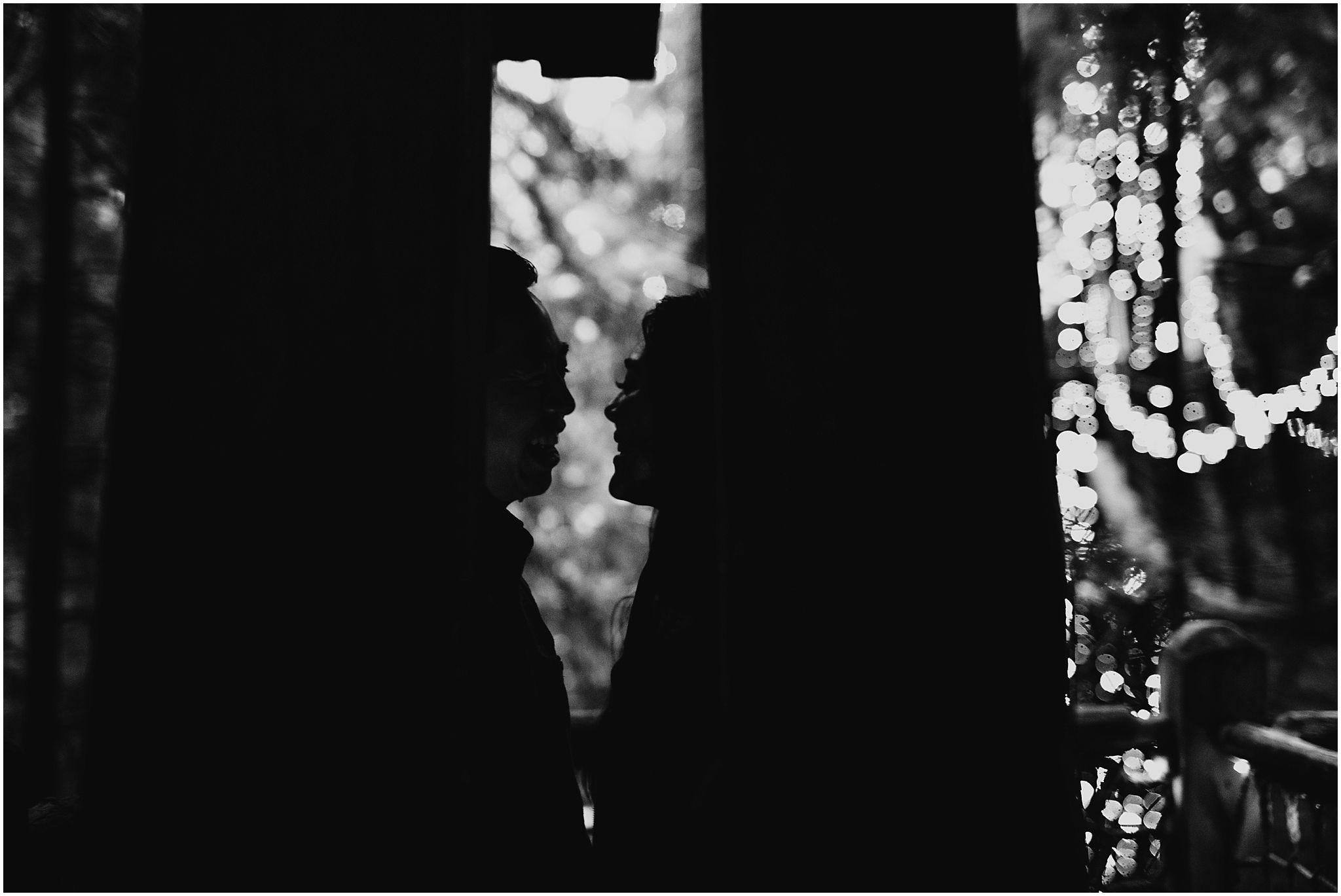 couple silhouette capilano suspension bridge treetop canyon lights