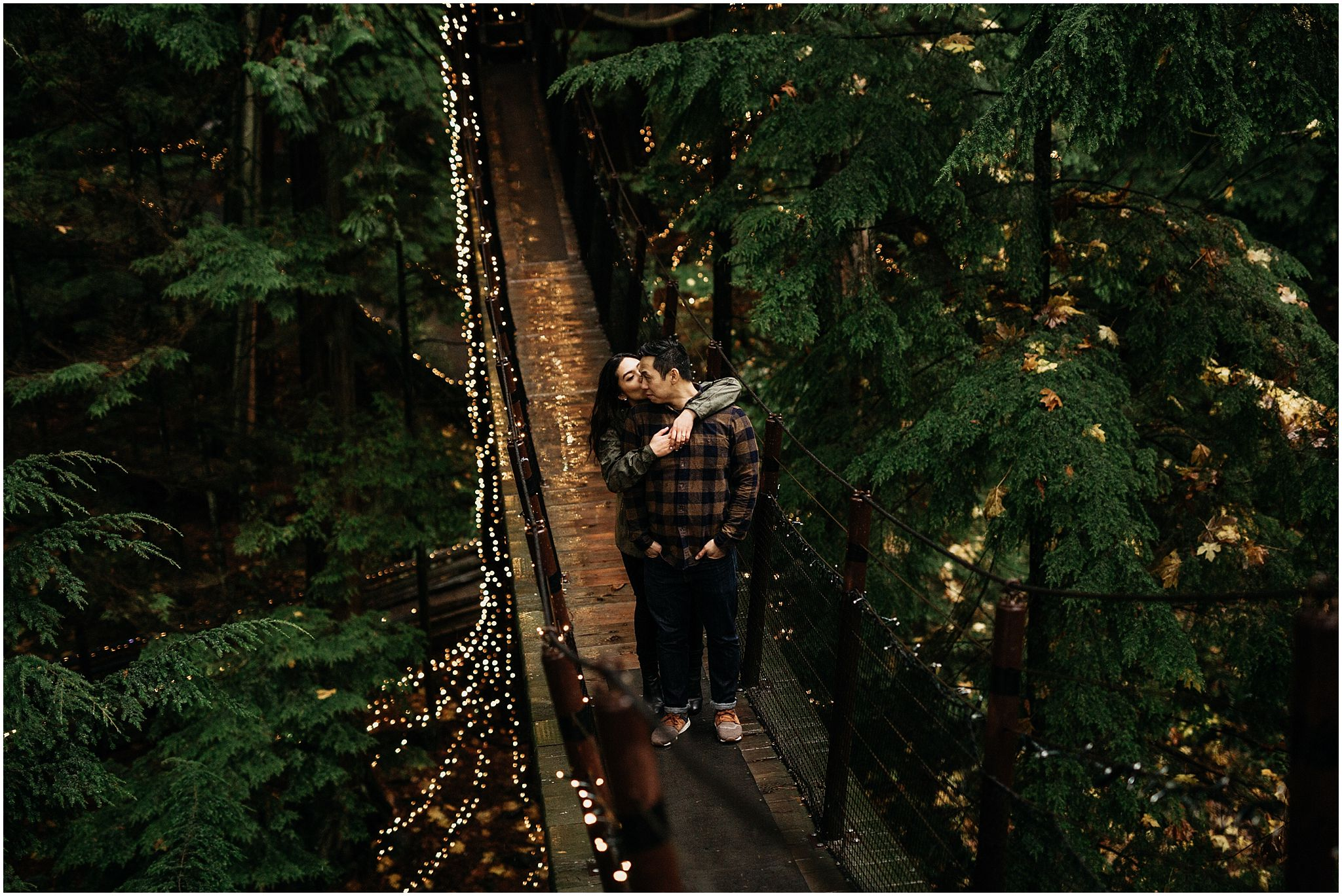 capilano suspension bridge canyon lights engagement photos couple hugging