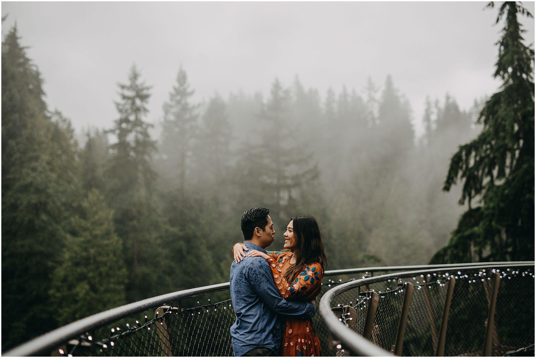 couple intimate moment on cliffwalk capilano suspension bridge engagement photos