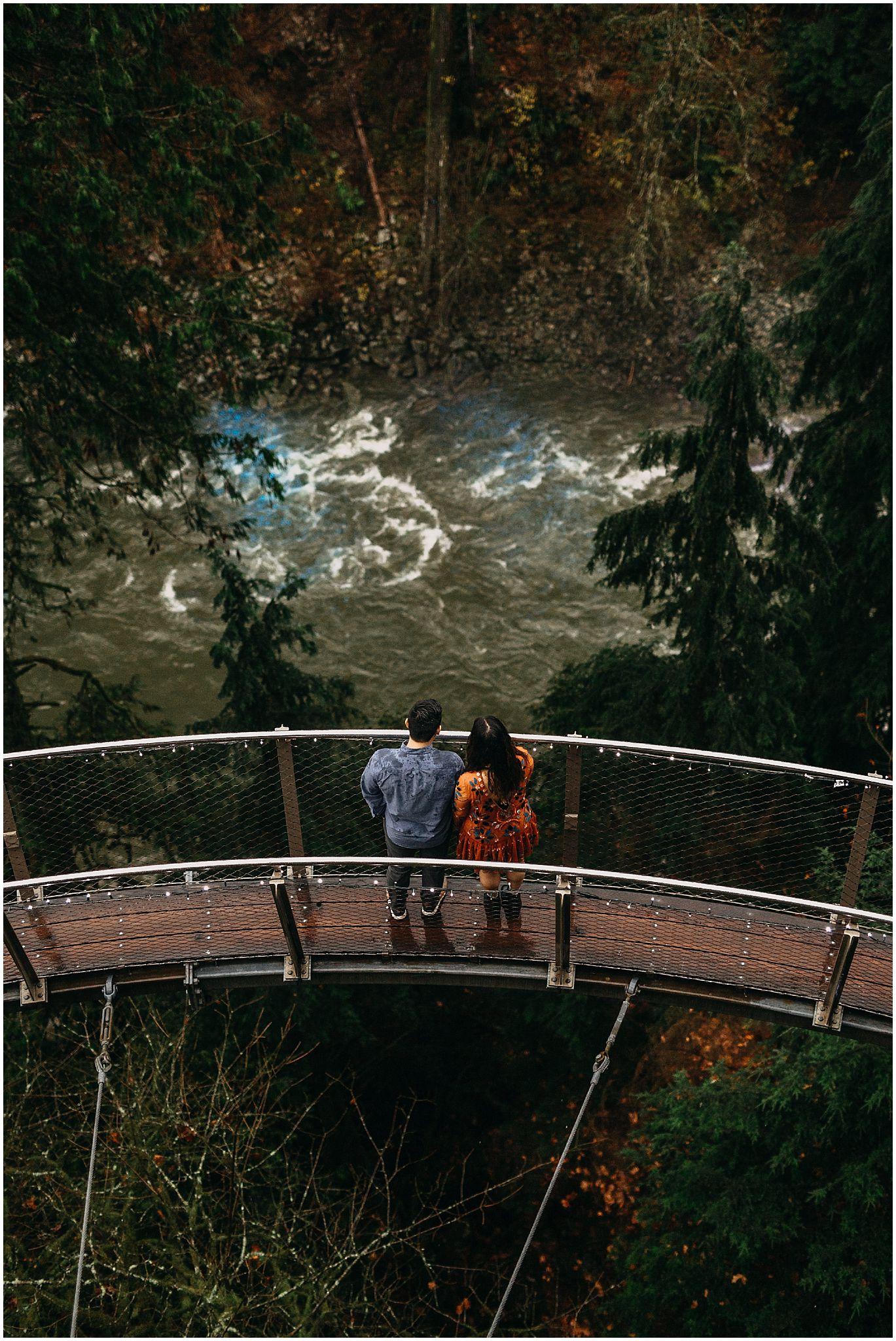 couple walking on cliffwalk capilano suspension bridge engagement photos