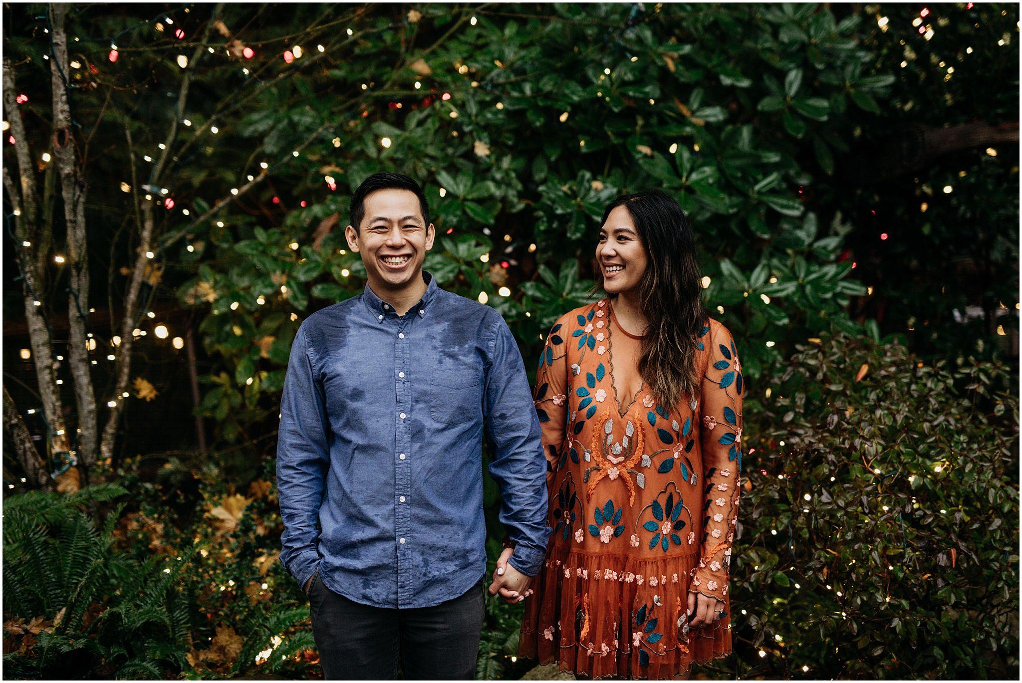 couple holding hands canyon lights capilano suspension bridge engagement