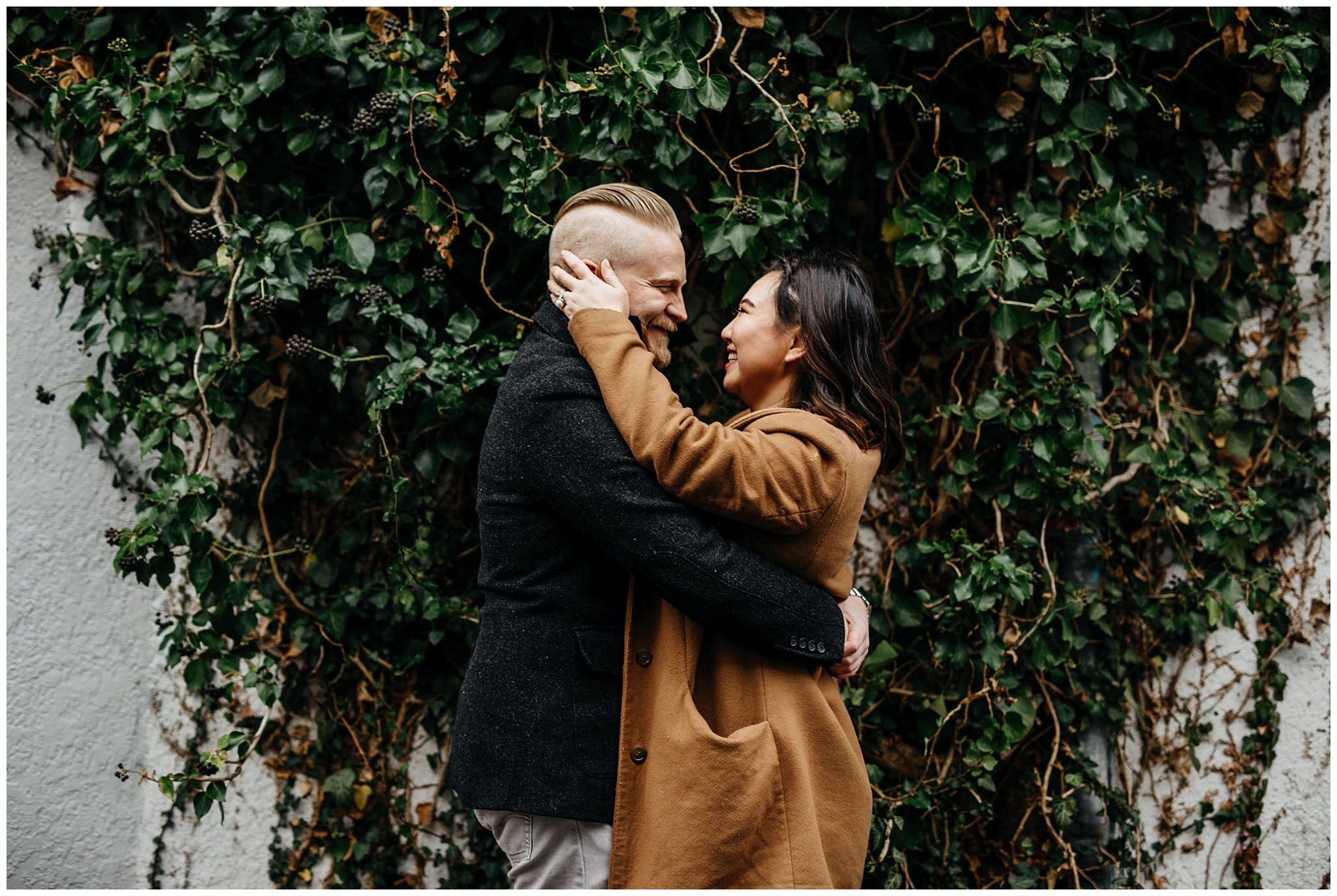 engaged couple in love vancouver alley ivy vine wall engagement