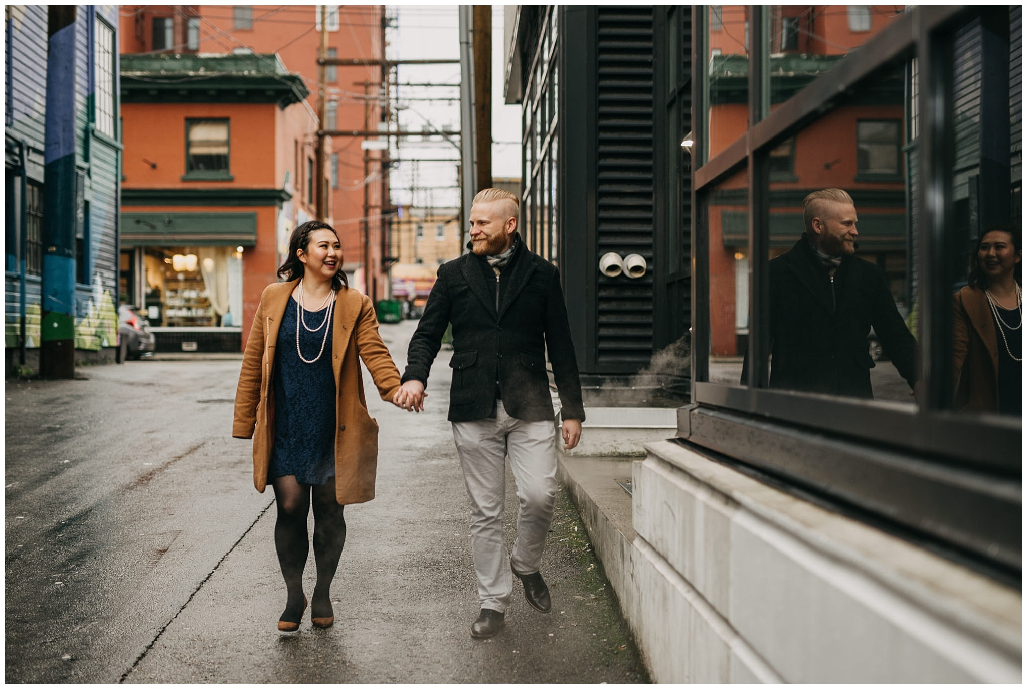 engaged couple holding hands walking vancouver alley city