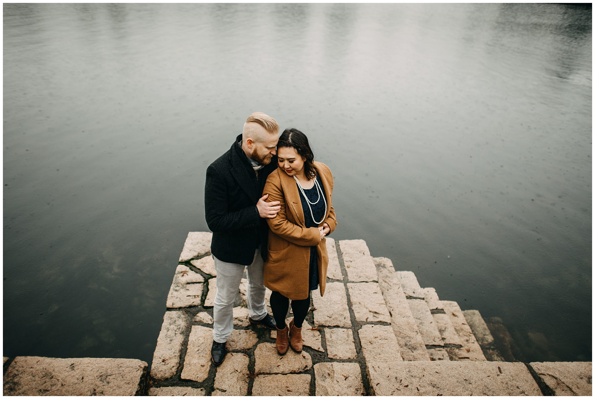false creek granville island engagement photos couple on stairs water