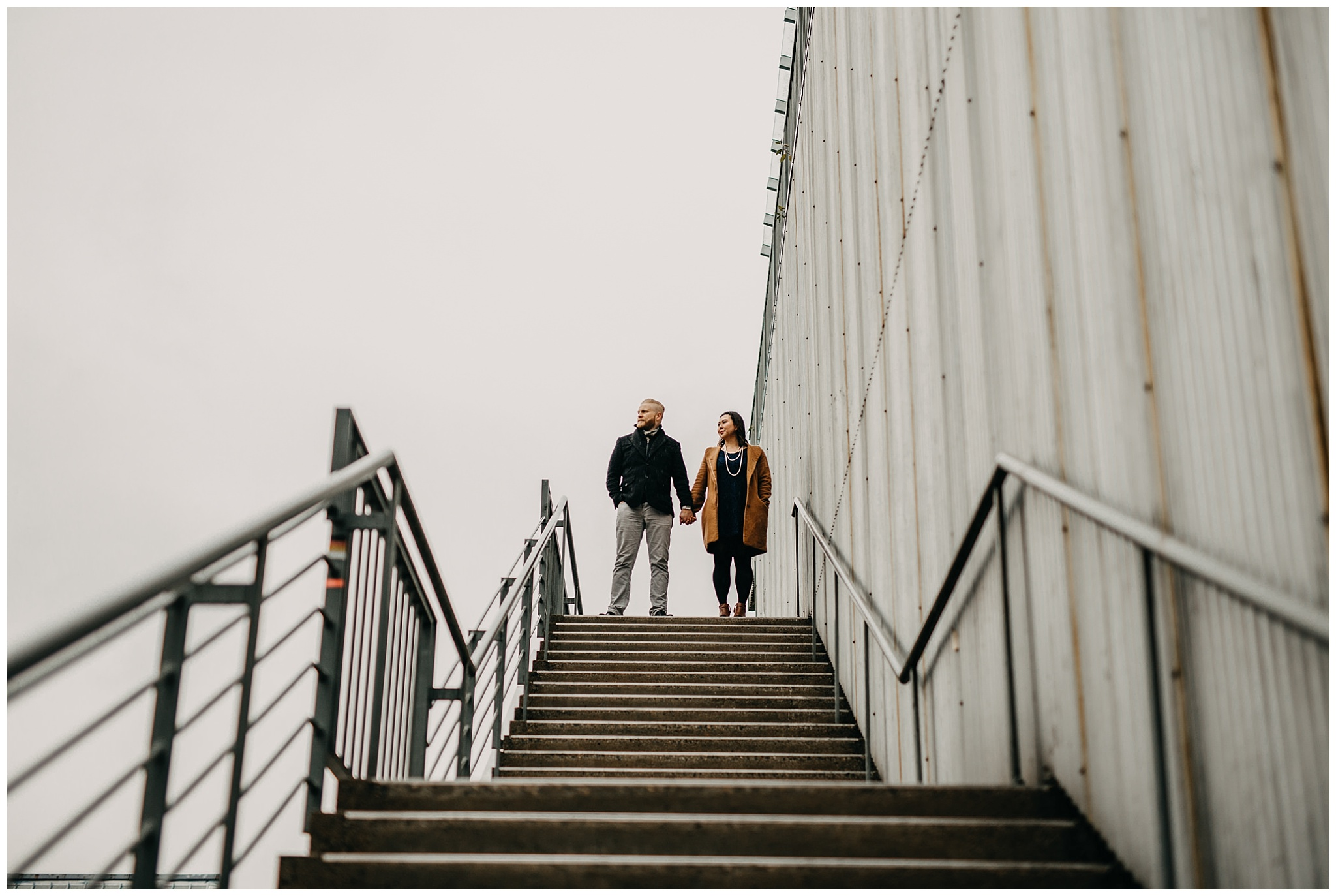 couple standing top of stairs granville island emily carr university