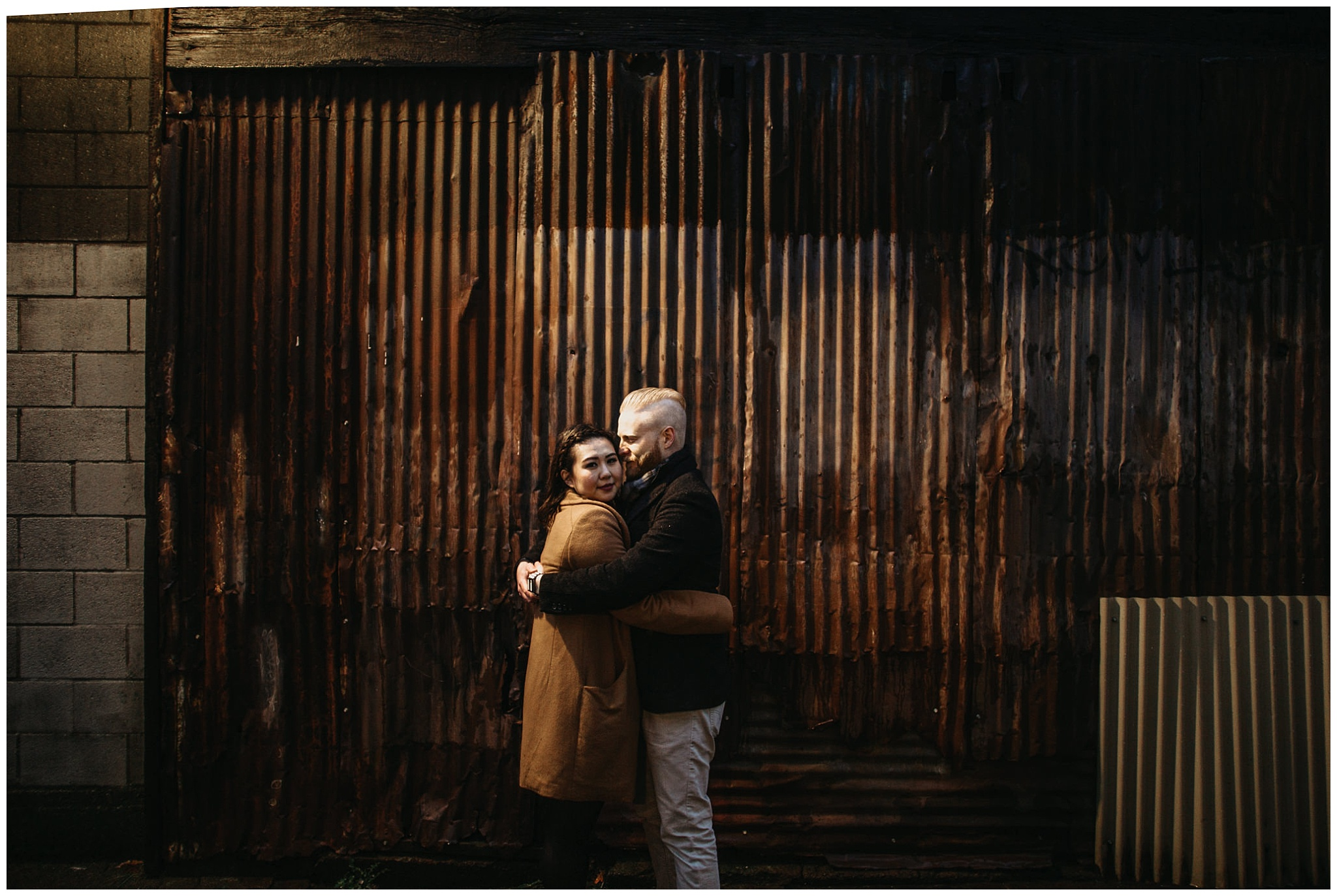 couple engagement metal rustic industrial city vancouver granville island