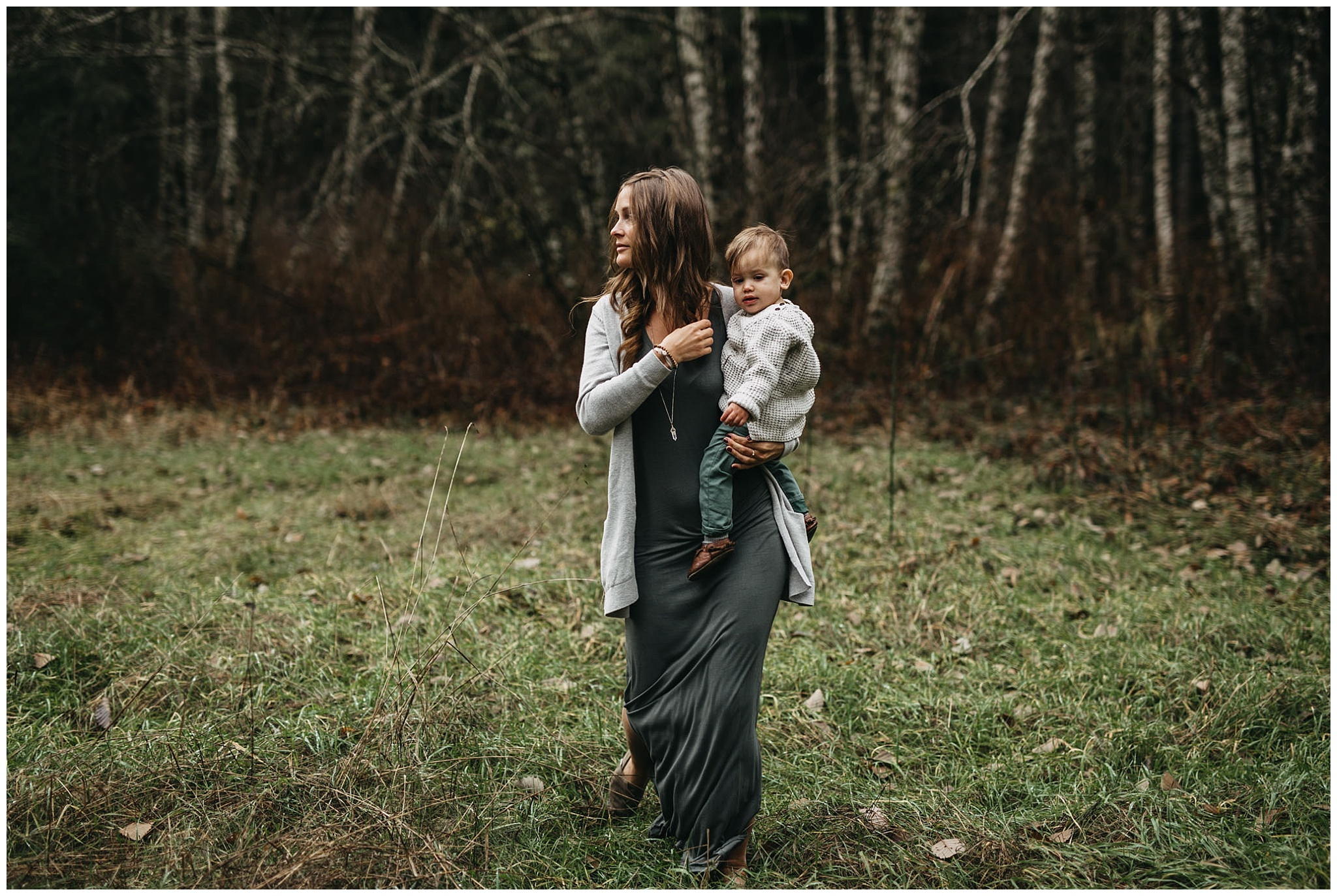 mom holding son walking through forest chilliwack family photos